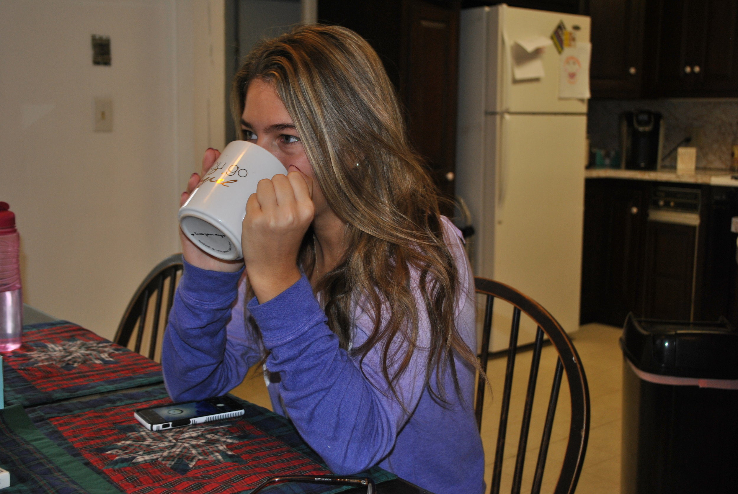 Sam Masetti drinking coffee as she described almost missing her final exam.