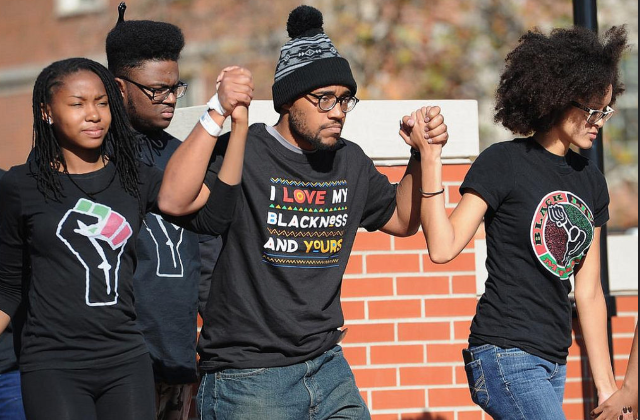 Jonathan Butler, the face of the student lead protest at the University of Missouri, walking through campus after President Tim Wolfe announced his resignation.  (Photo by Karen Cyars)