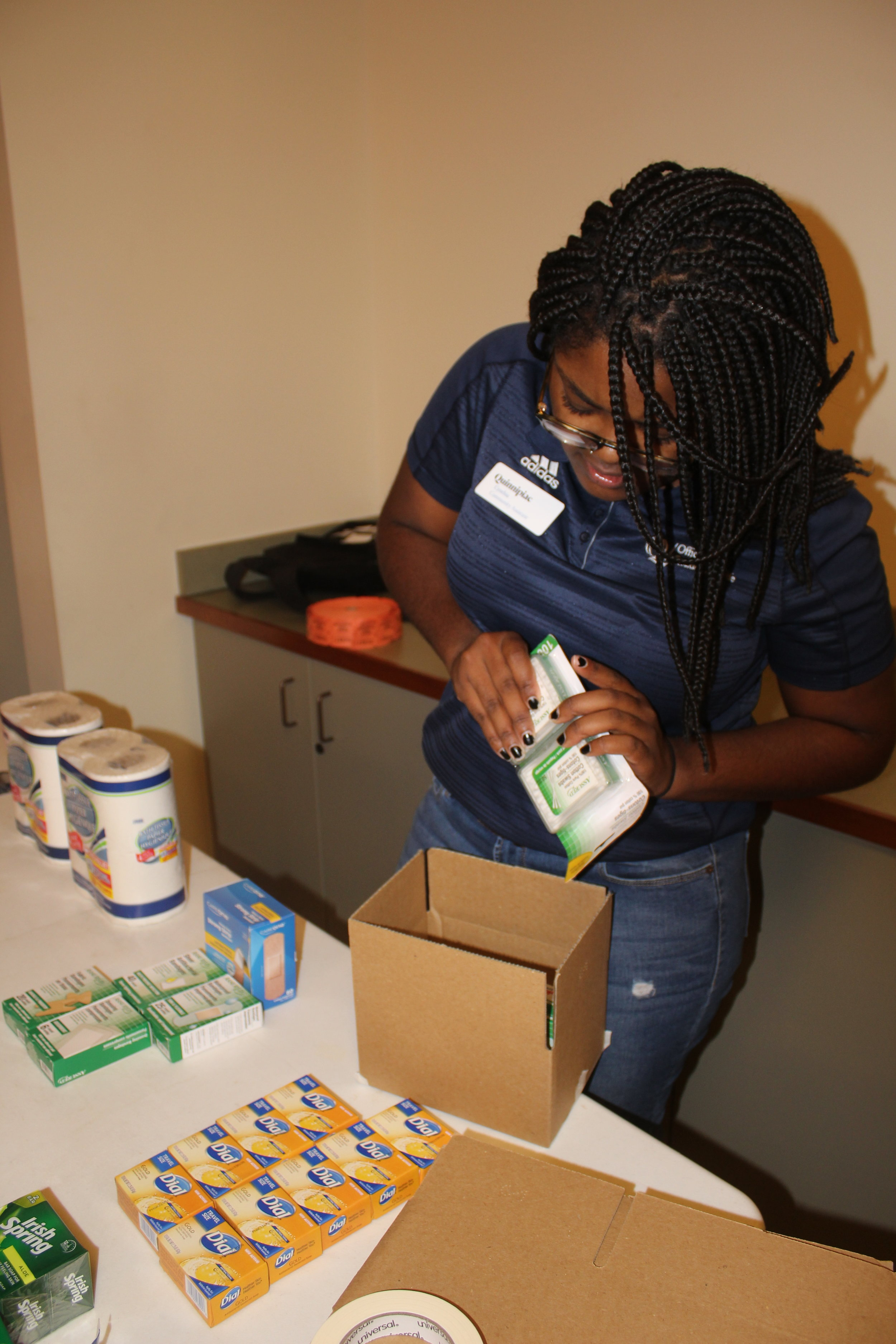 Community Assistant Cynthia Clements making a care package for Homes for the Brave