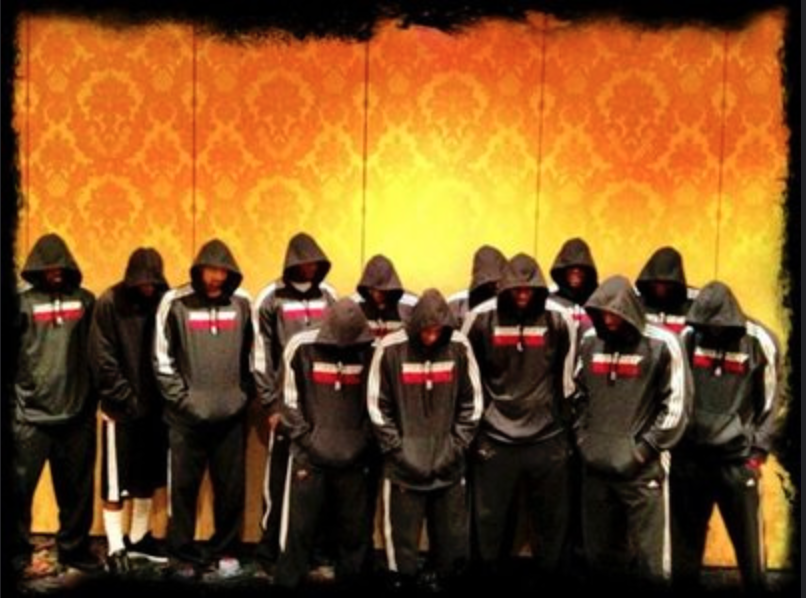Members of the Miami Heat wear hoodies in support of Trayvon Martin after he was gunned down by George Zimmerman, a neighborhood watch volunteer.