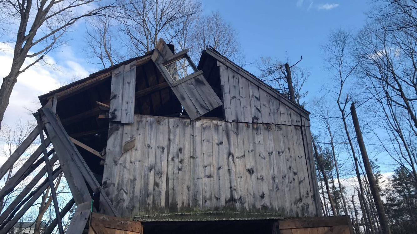 The exterior damage of the Cider Mill Barn.