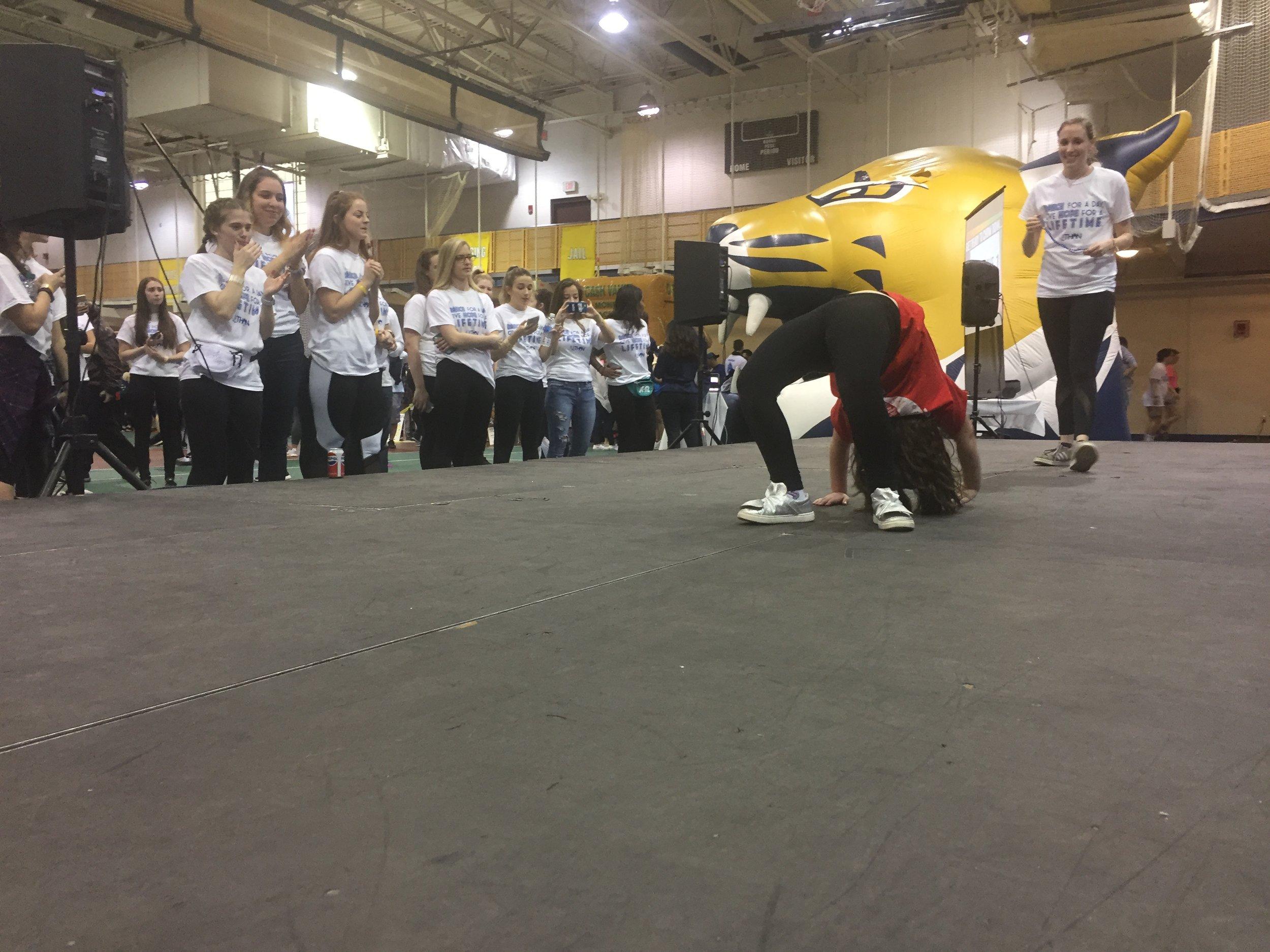 Miracle Child, Bianca, shows off her gymnastics skills at the 2018 QTHON dance marathon