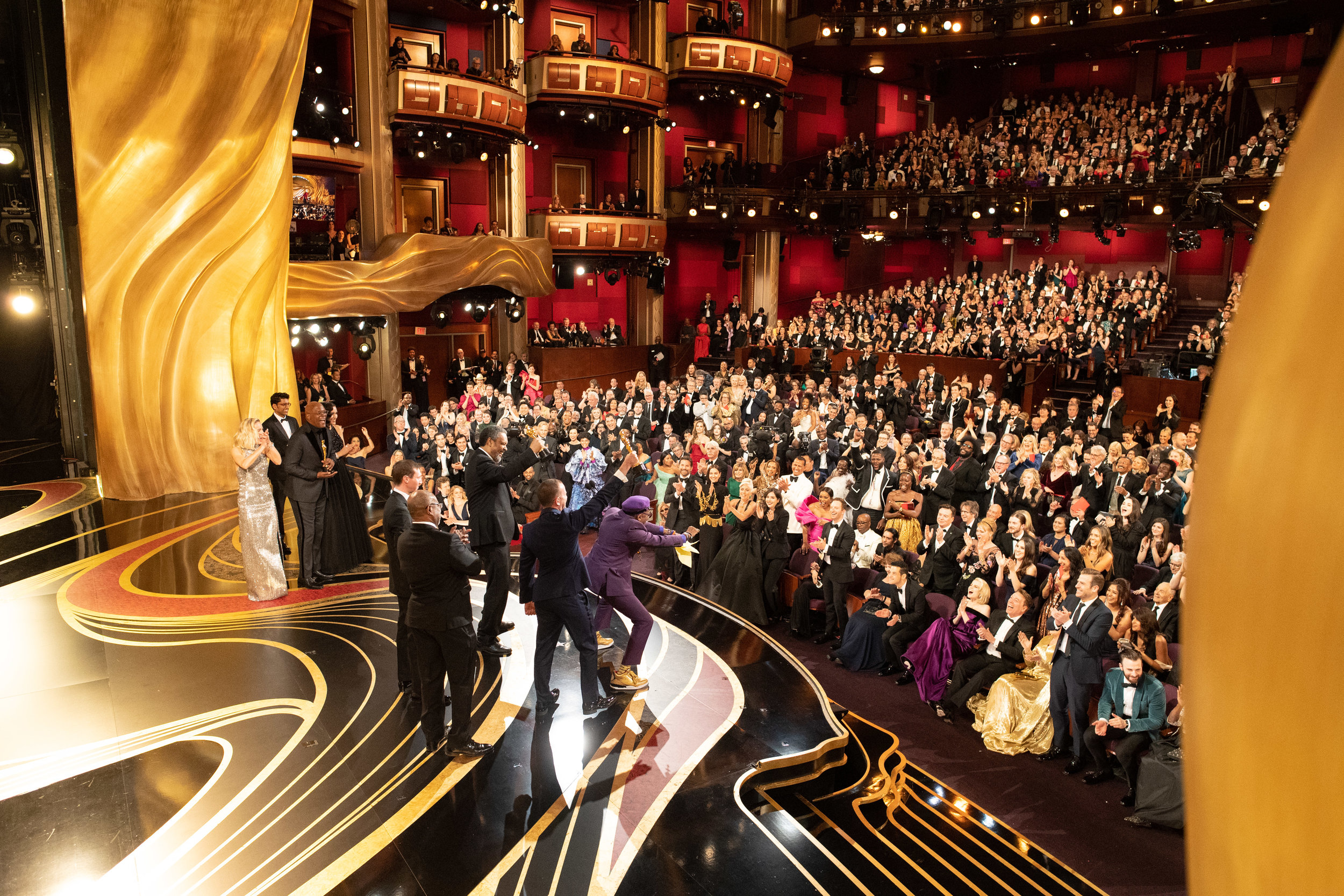 Rabinowitz, Wachtel, Lee and Kevin Willmott accepting their Oscars for Best Adapted Screenplay on stage with presenters Brie Larson and Samuel L Jackson.  Photo courtesy of 91st Oscars® Press Kits.