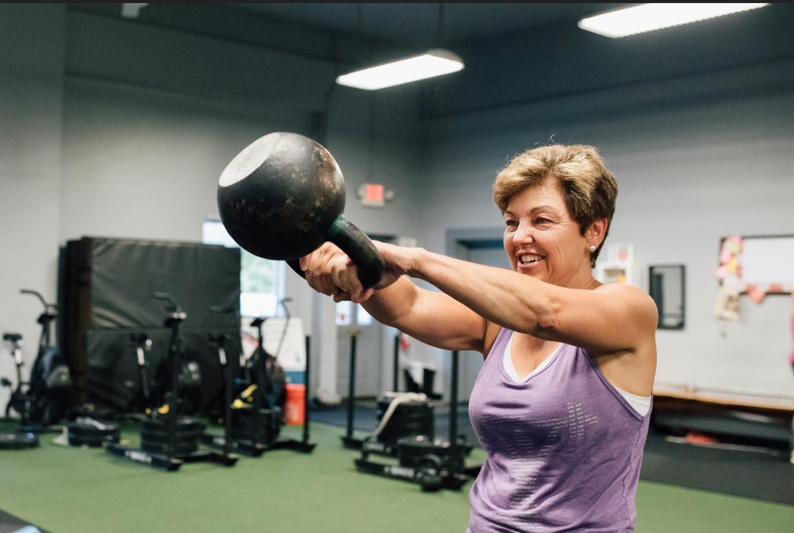 Tuff Girl Fitness Member Barbara Esposito lifting kettlebells  Photo by Brigid Hect Photography