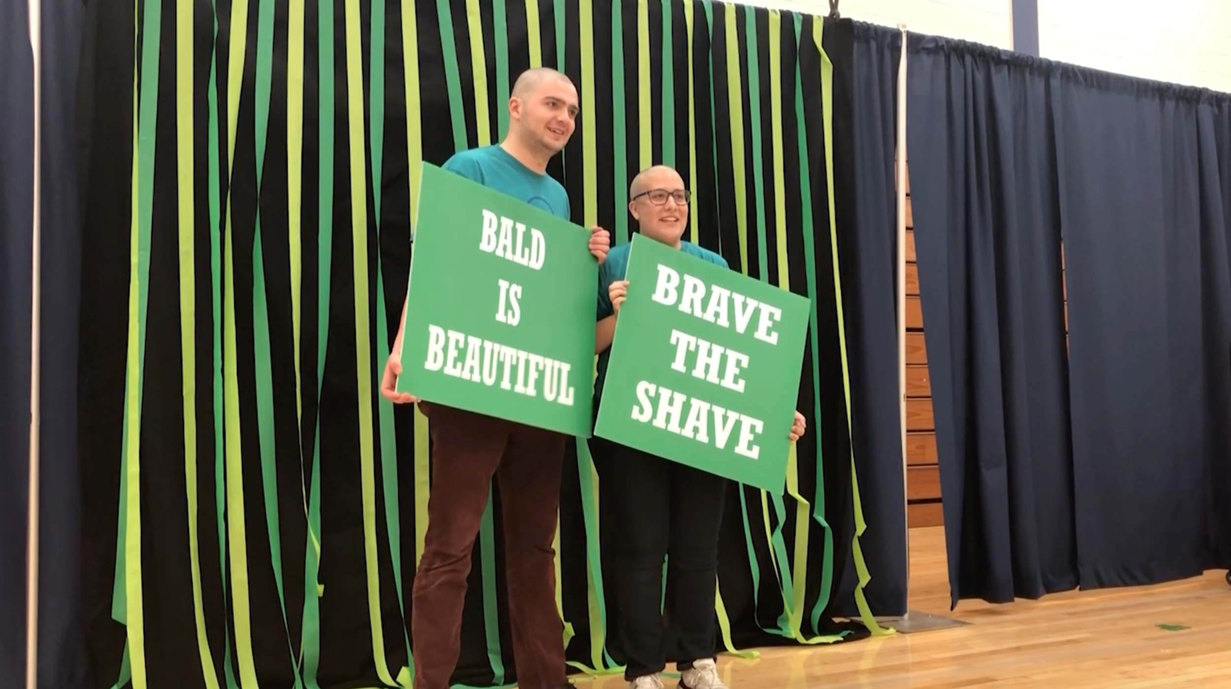 "Event coordinators, Luke Ahearn and Emma Shipton, ""braved the shave"" on Monday night."