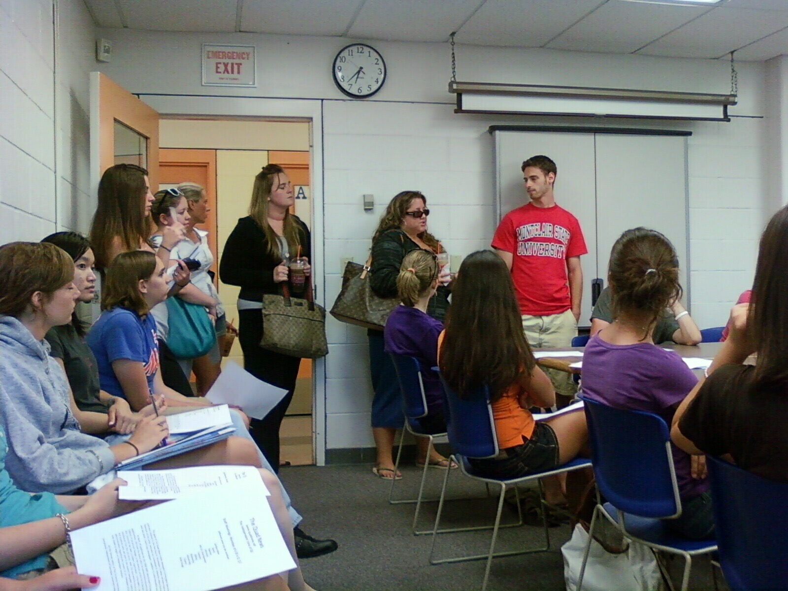 One of The Quad News' first meetings. Jason Braff stands in red (right).  Photo courtesy of Margarita Diaz