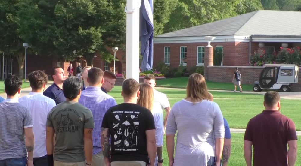 Students gathered in front of Carl Hansen Student Center for remembrance flag ceremony on Sept. 1, 2019.