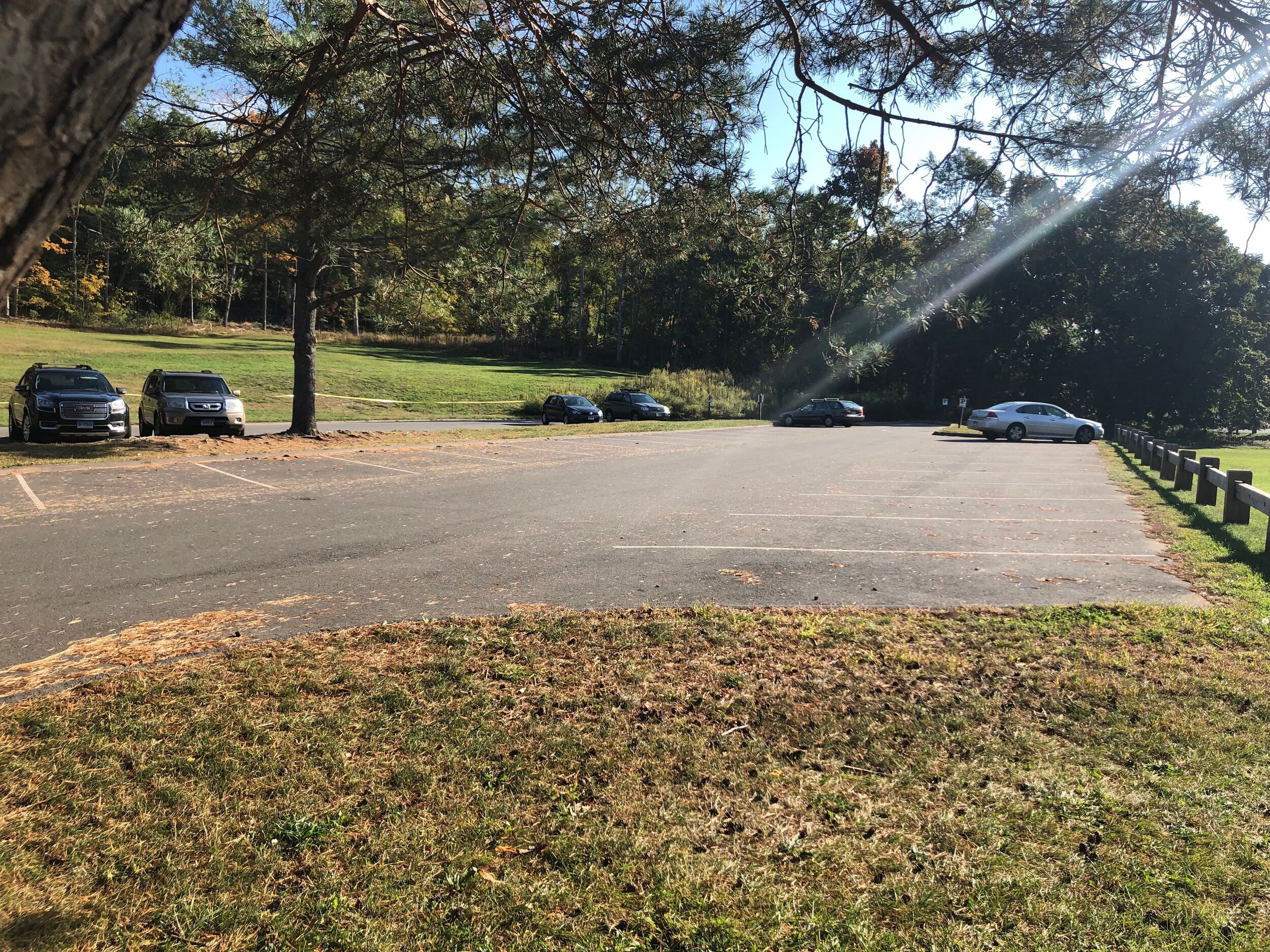 The parking lot of Sleeping Giant State Park was nearly empty on a sunny and warm Wednesday morning.