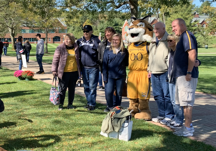 One family poses with Boomer the Bobcat on the quad.