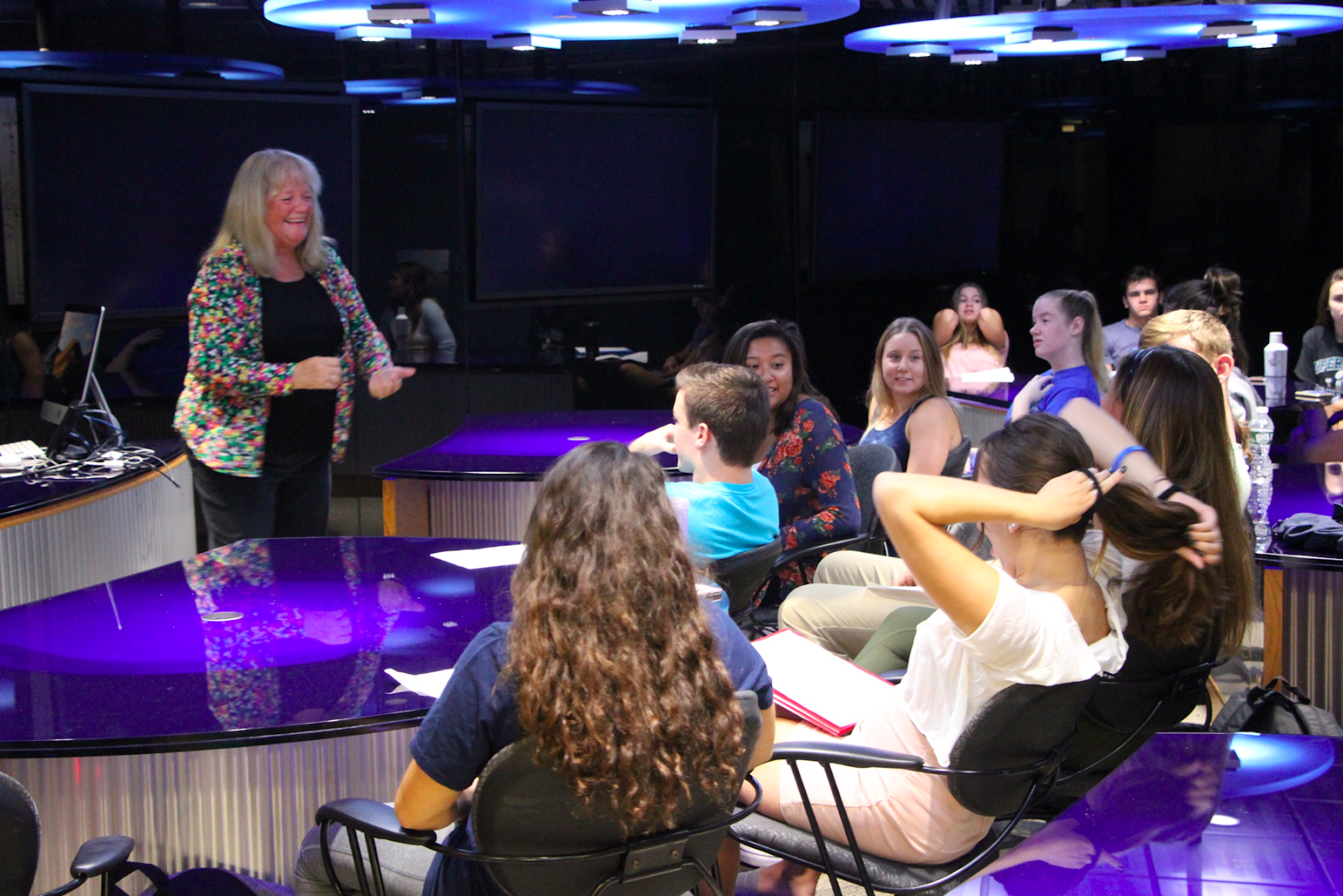 Professor Terri Corigliano teaches her public speaking course with a wide smile across her face.