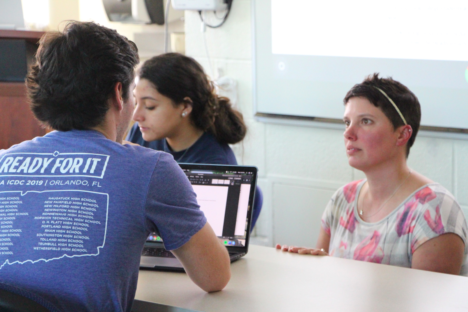 Professor Medina assisting a student with a question for a project.