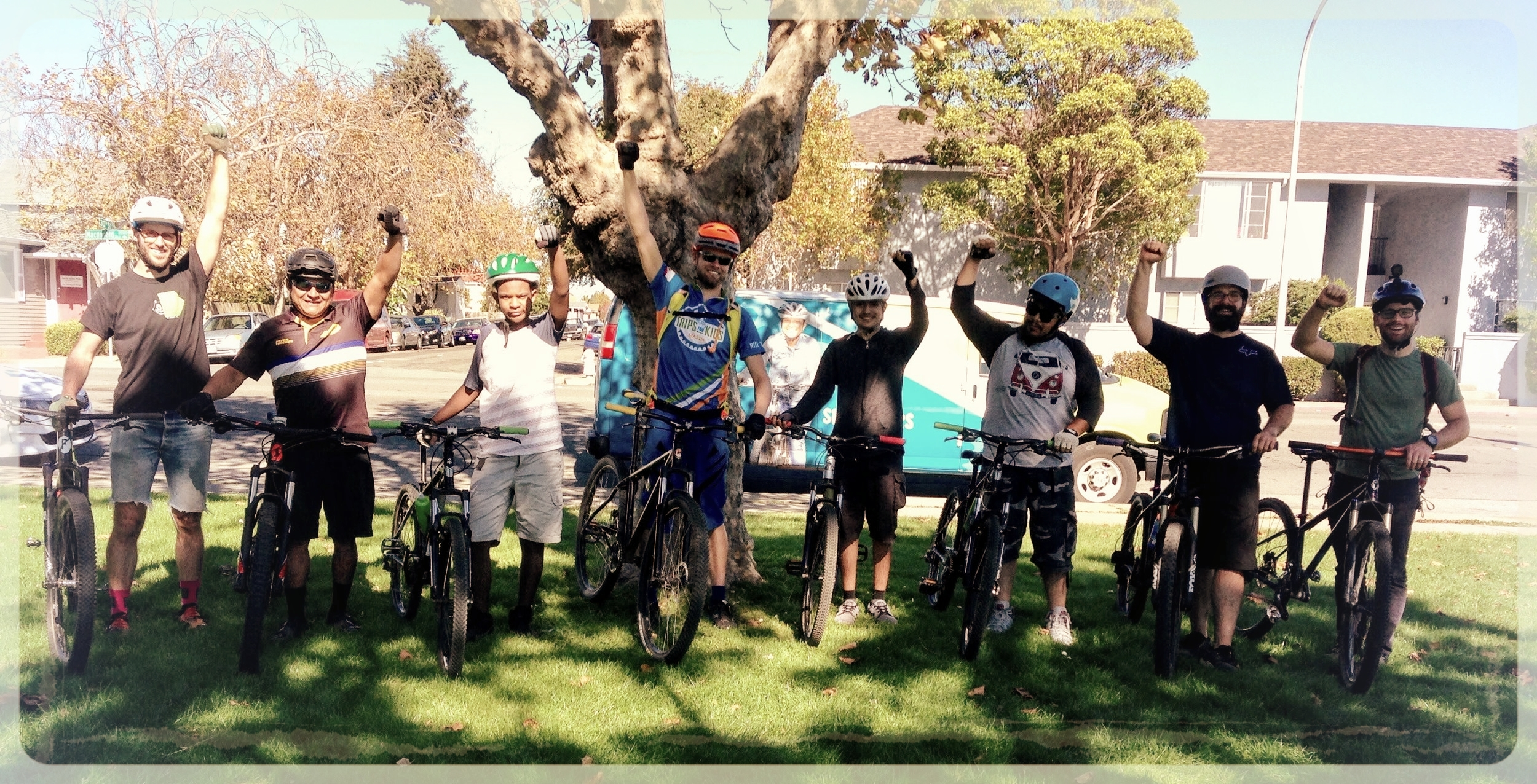 Two student riders and a bunch of enthusiastic adults at the first Fun Ride