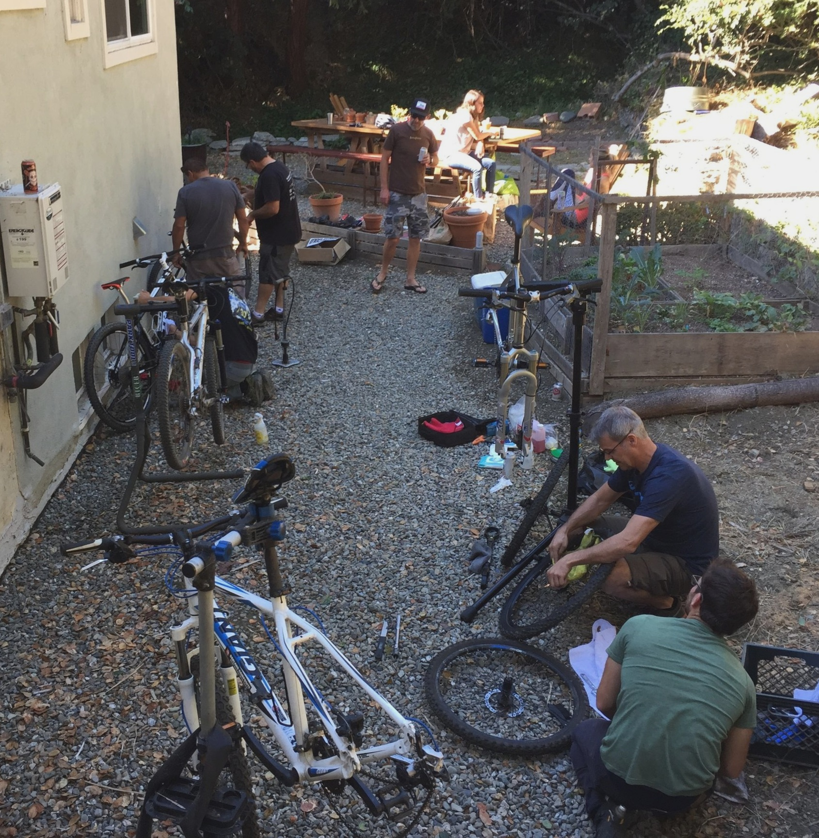 Coaches gather early in the first season to fix up donated bikes to loan out to kids. 80% of team riders need a loaner bike to participate on the team.