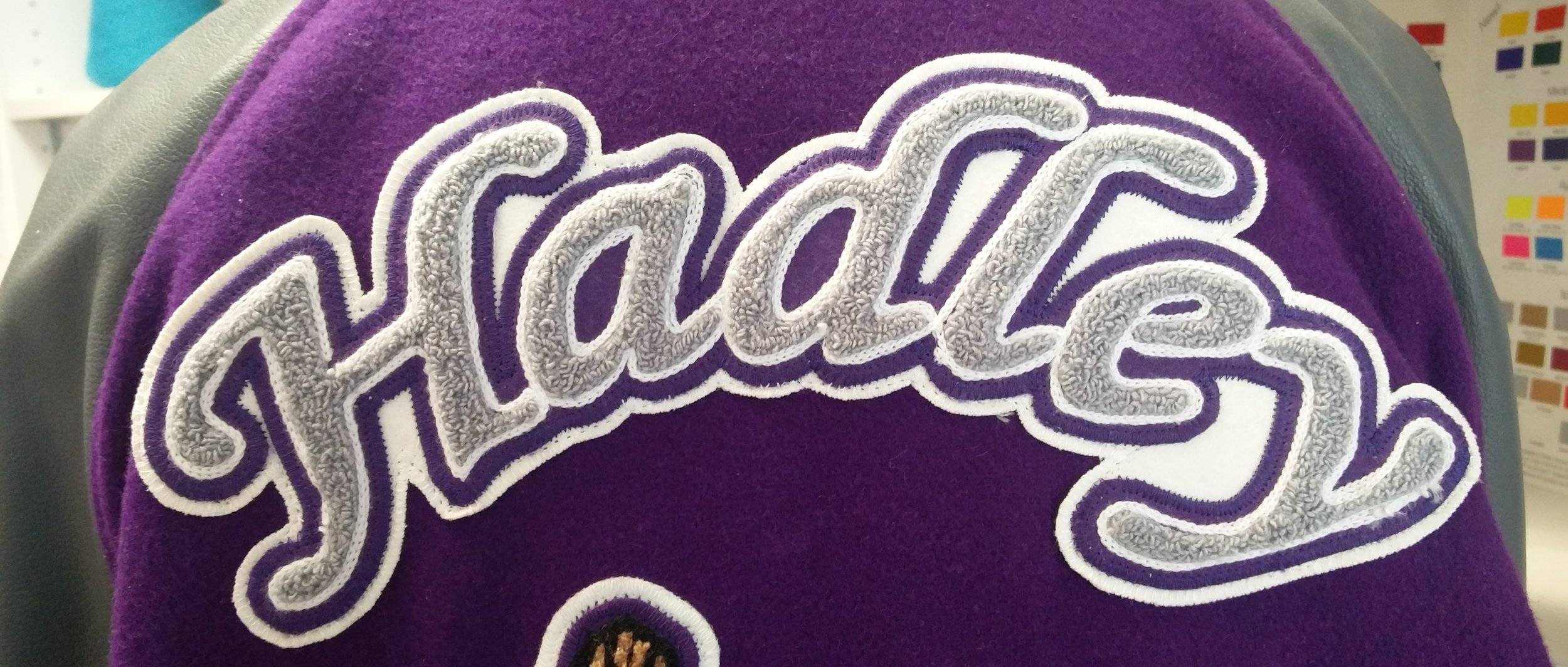 Last Name - Customers pick from a variety of font samples. This patch is placed on the back of the jacket.