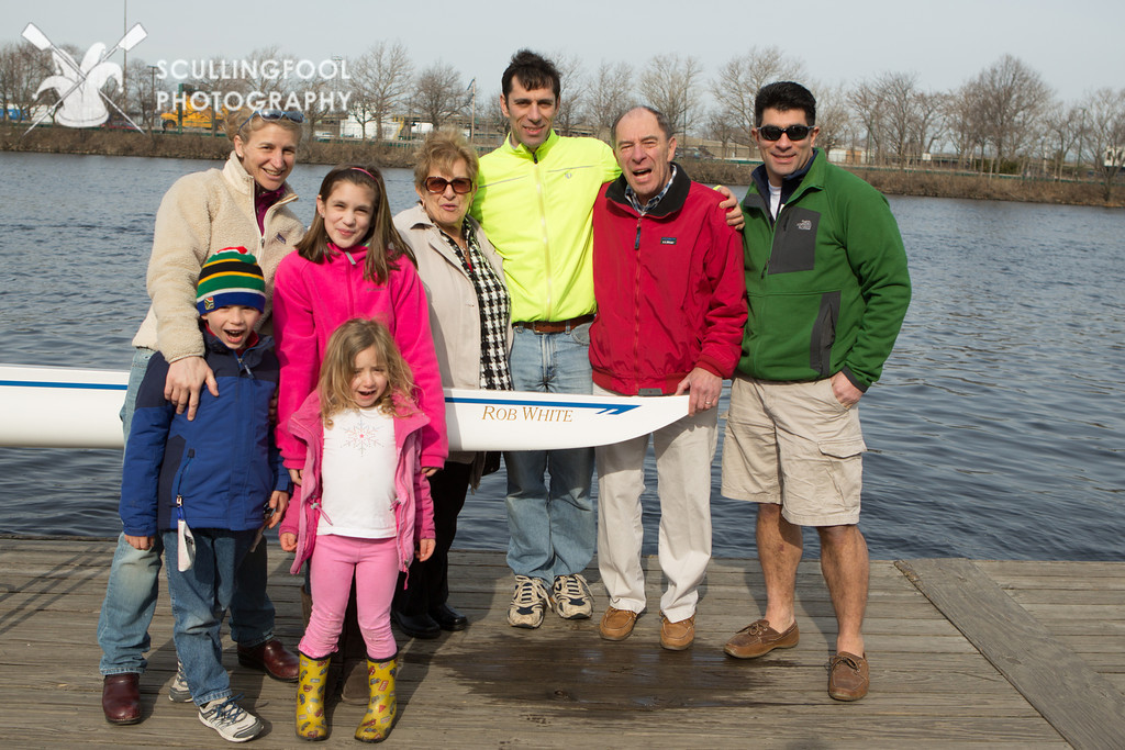 Rob with his family at his boat dedication.