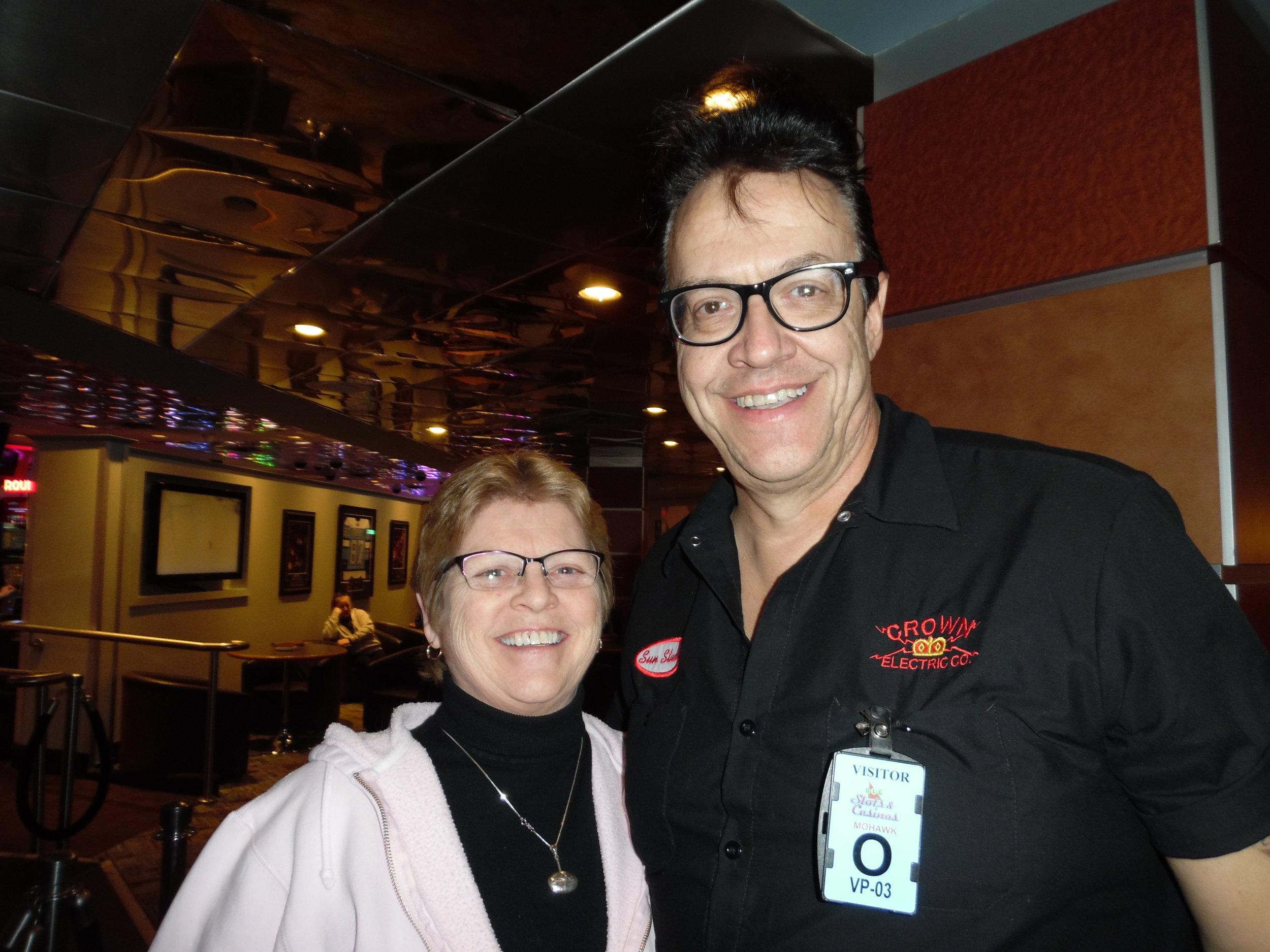 Fan, Linda, poses for a photo with ETA  Brent Freeman  at Mohawk Raceway.