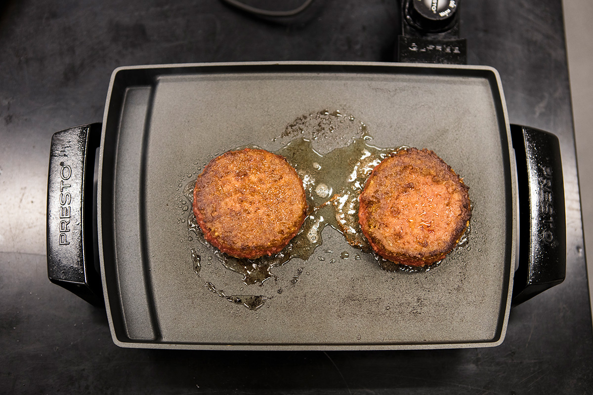 frying up some patties in the beyond meat research lab
