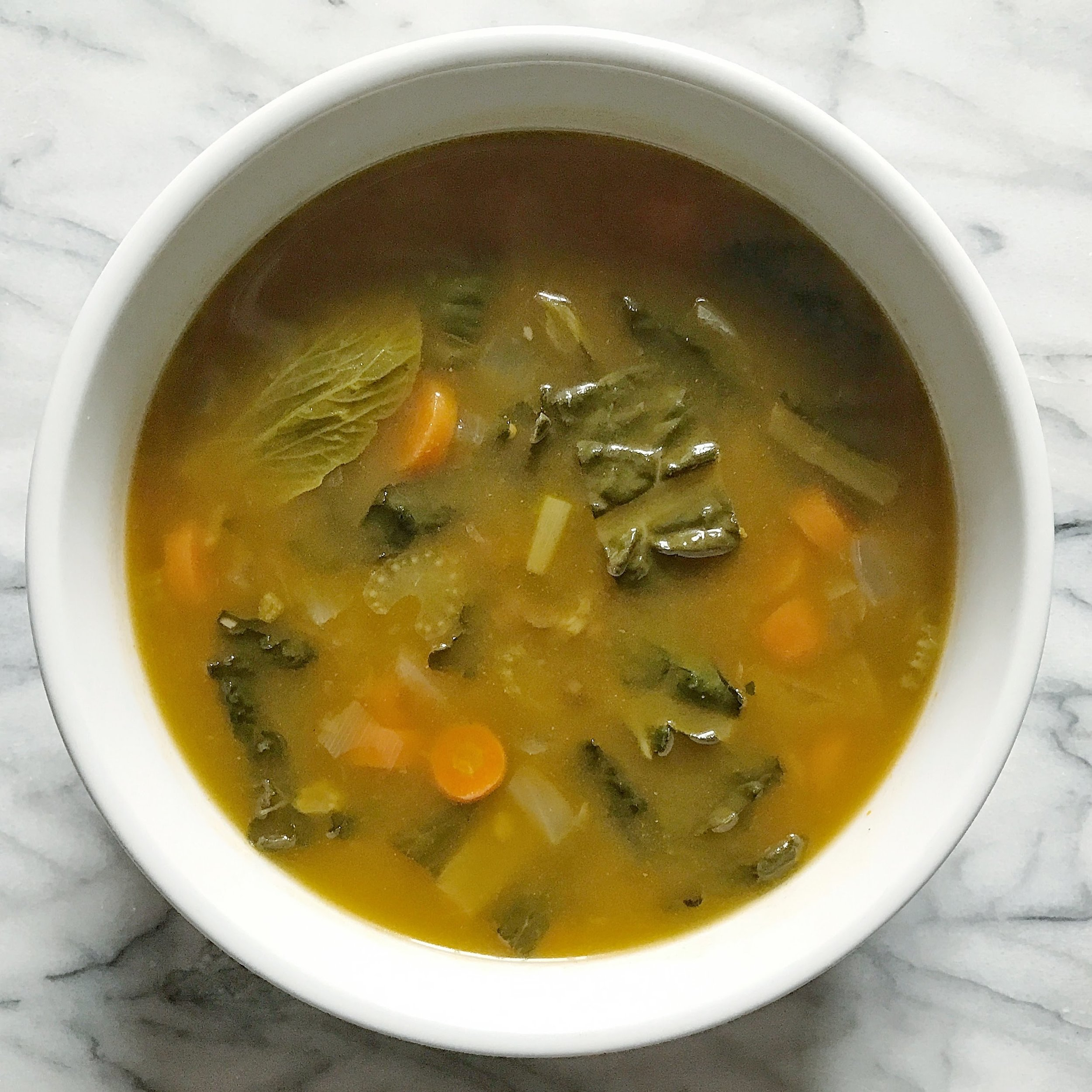 My WomanCode soup that I made a large batch of before the cleanse. It's made with veggie broth, Tuscan kale, carrots, onions, lentils, bok choy, and some herbs.