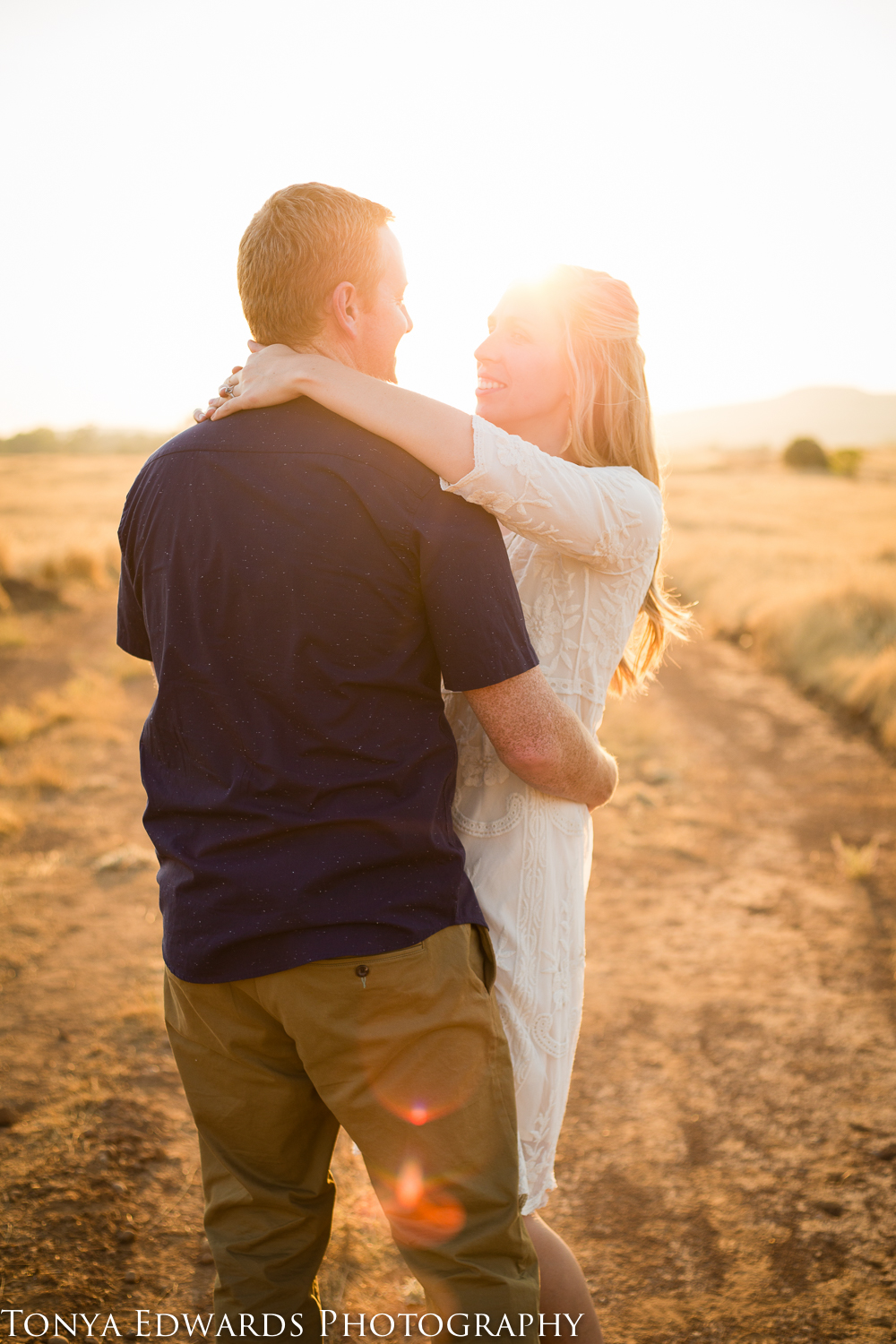 Tonya Edwards | Oroville Family Photographer | married couple dancing at sunset