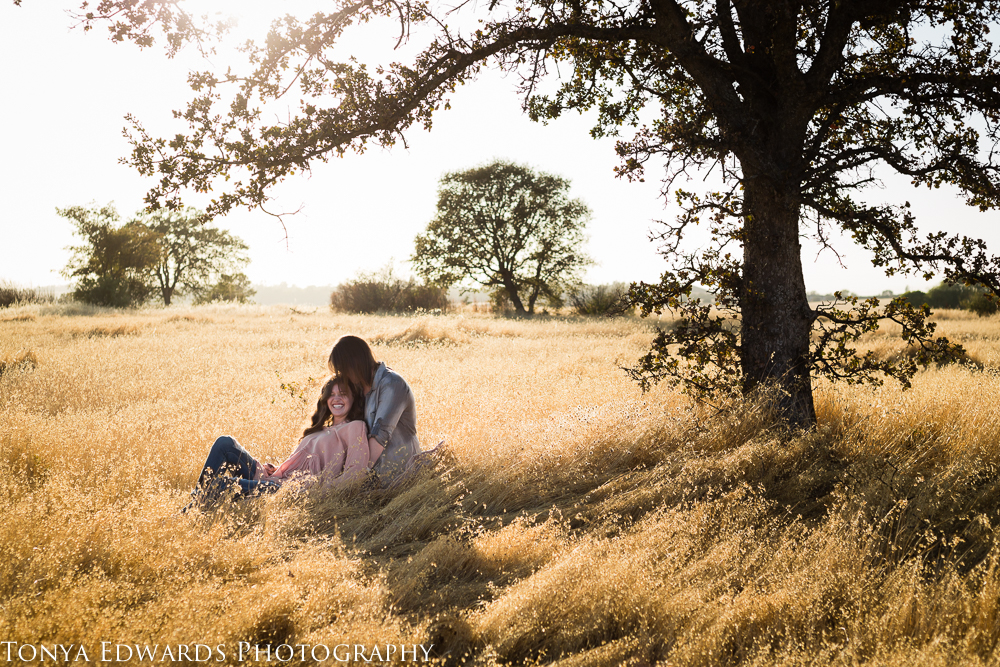 Tonya Edwards | Oroville Family Photographer | mother daughter moment under a tree in a field