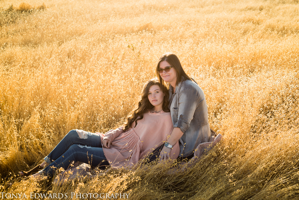 Tonya Edwards | Oroville Photographer | Mother and daughter in golden grass at sunset