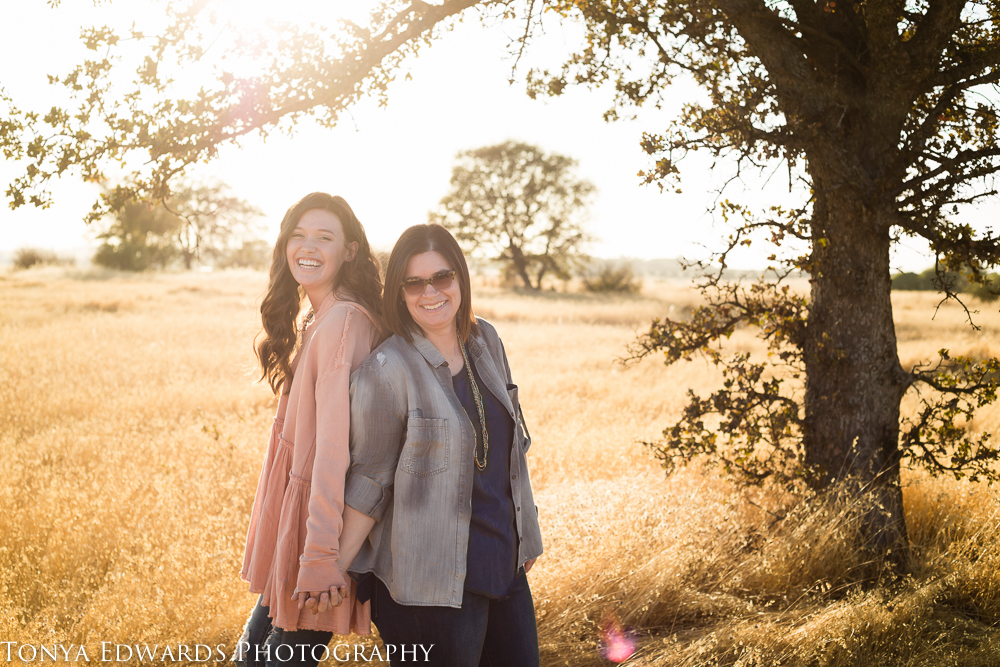 Tonya Edwards | Oroville Family Photography | mother and daughter standing under a tree laughing