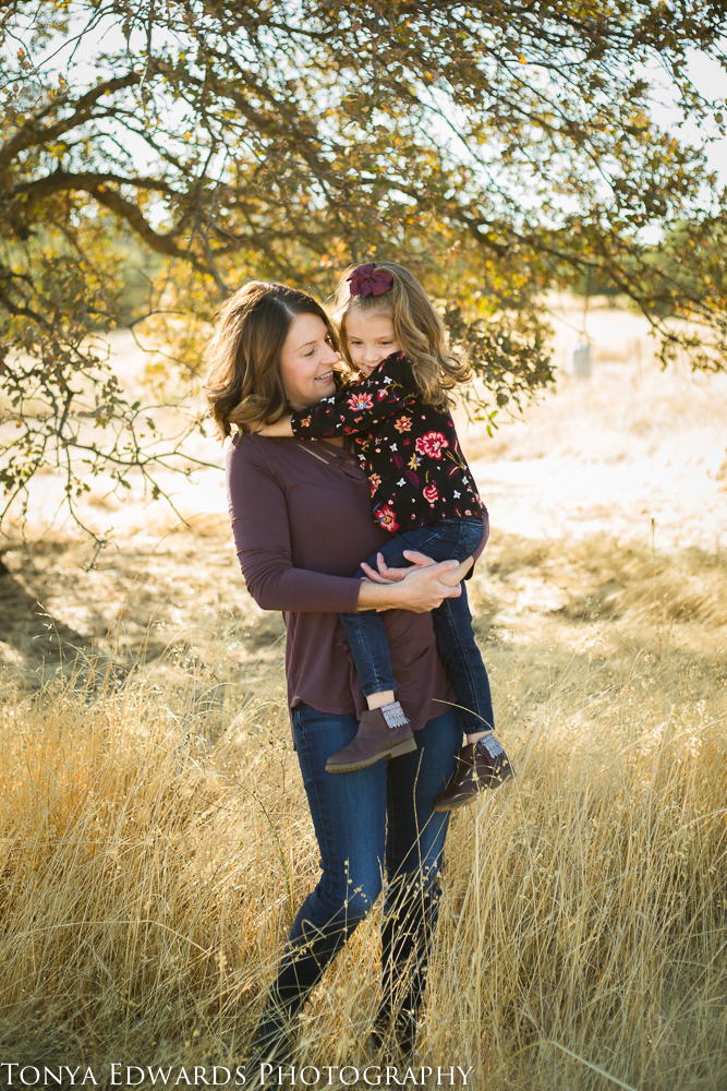 Tonya Edwards   Oroville Photographer   lifestyle picture with mother and daughter twirling