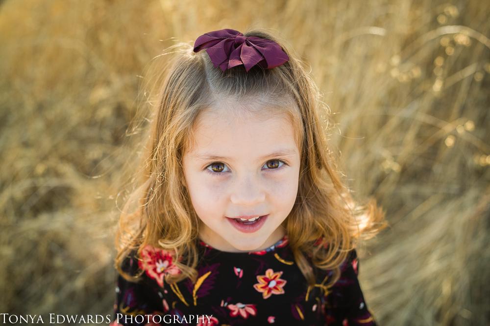 Tonya Edwards   Oroville Family Photographer   cute little girl in golden sunlight