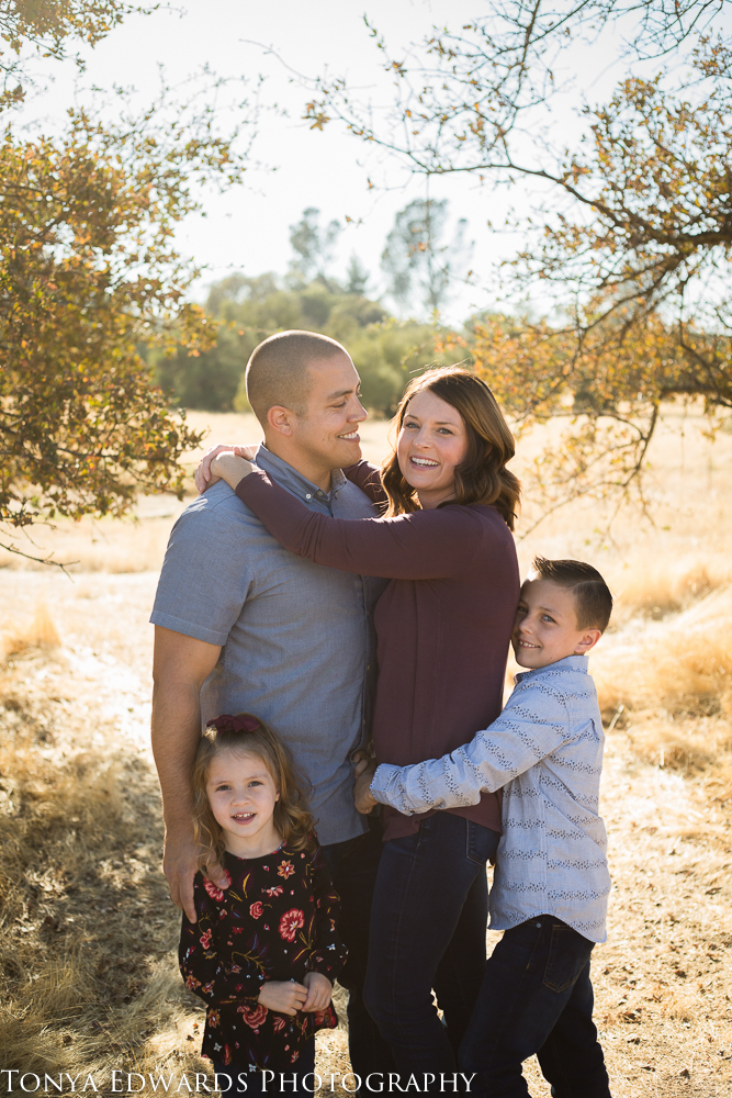 Tonya Edwards   Oroville Family Photographer   family of four standing hugging