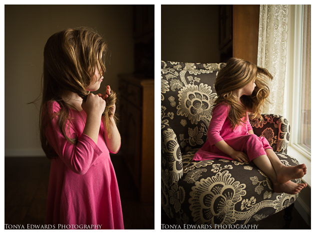 Oroville Photographer   Tonya Edwards   little girl in a pink dress twirling her hair by a window