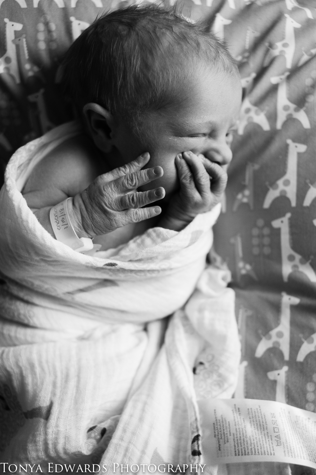 Tonya Edwards | Oroville Newborn Photographer | black and white photo of baby girl swaddled with wrinkled hands