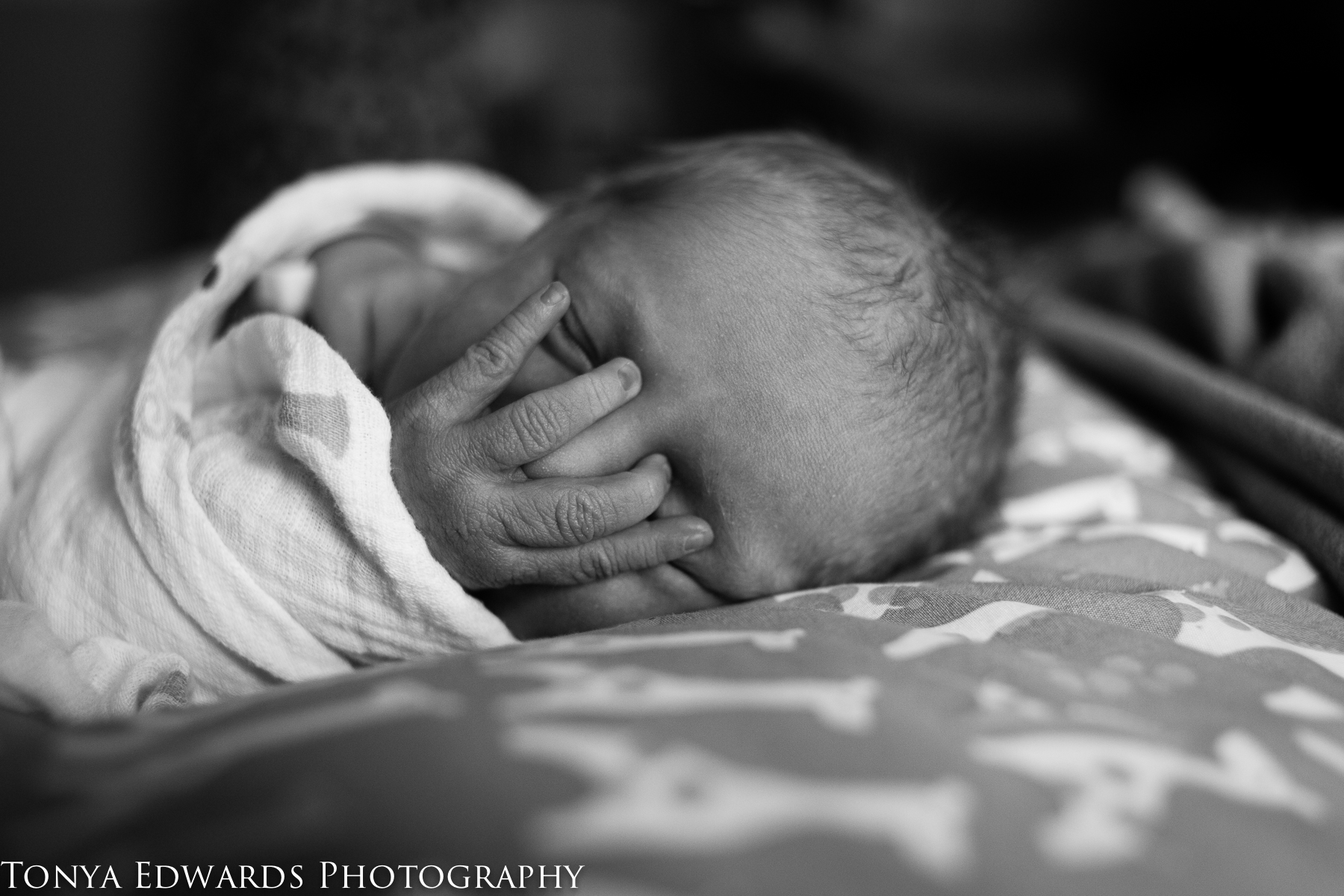 Chico Newborn Photographer | Tonya Edwards | black and white photo of fresh 48 baby covering her face with her hand