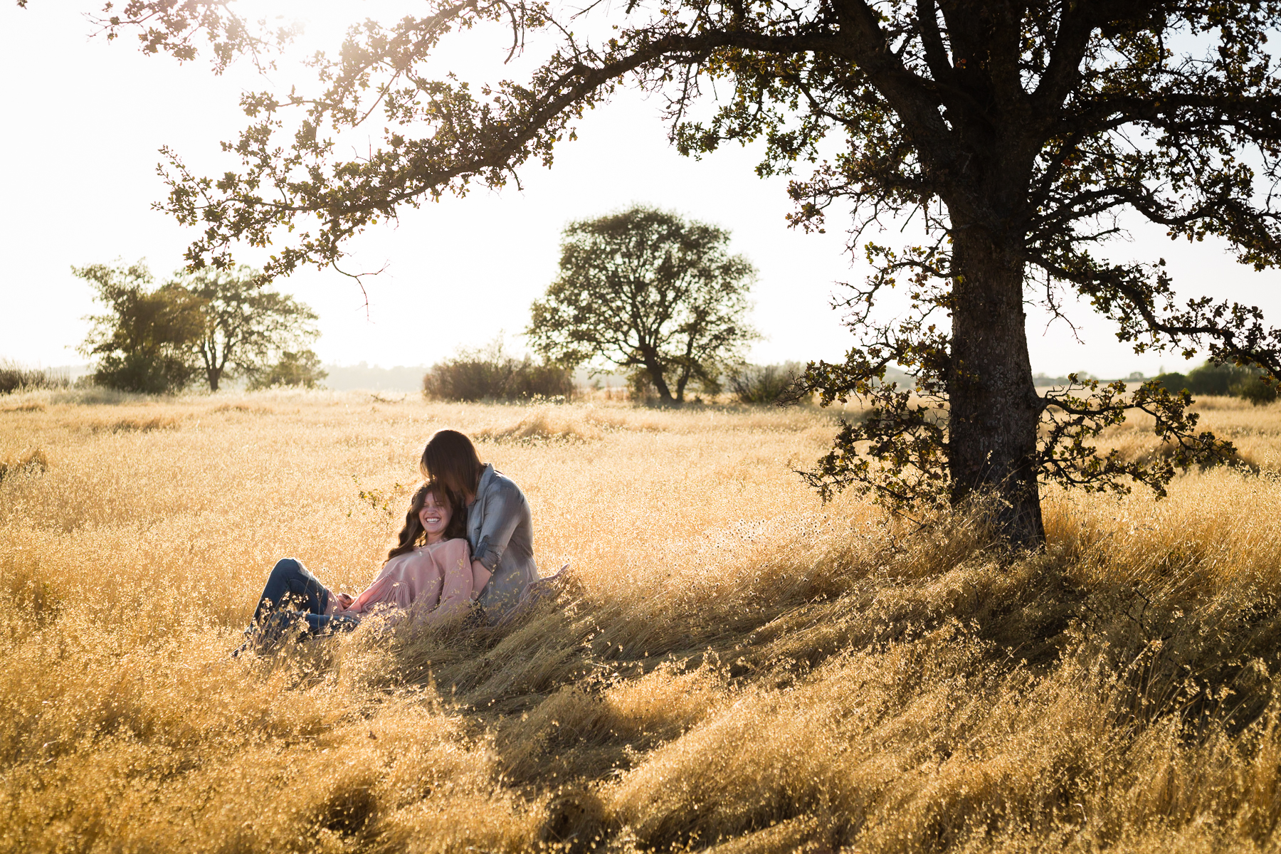Tonya Edwards | Oroville Family Photographer | mom and daughter sitting under a tree watching the sunset