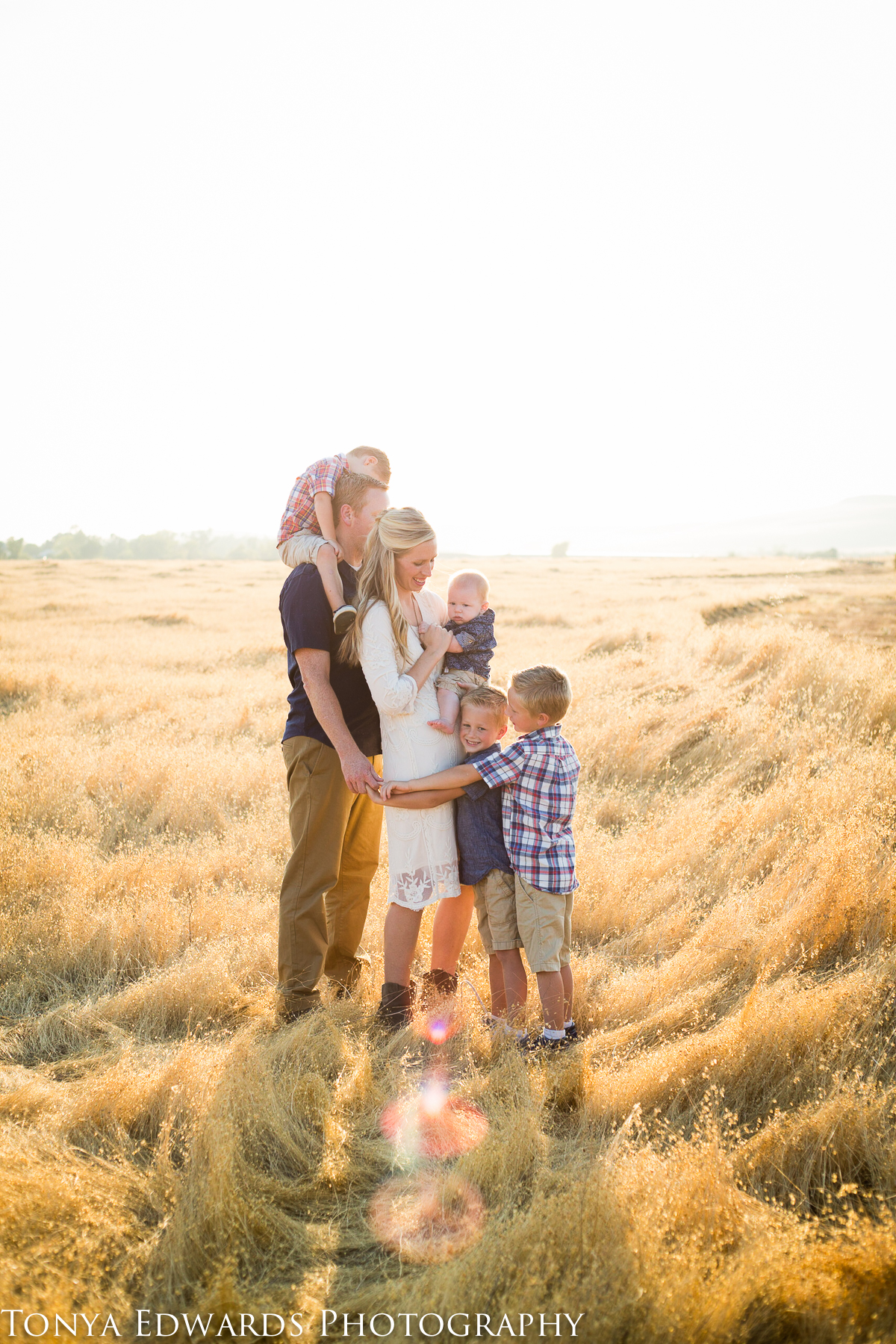 Tonya Edwards | Oroville Family Photographer | four boys and parents in a big family bear hug