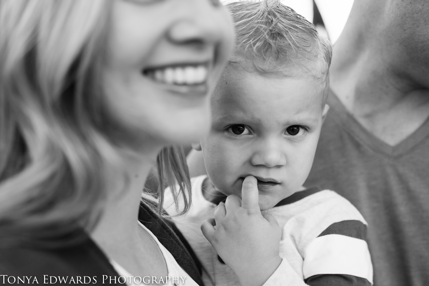 Tonya Edwards | Oroville Family Photographer | shy boy being held by his mama