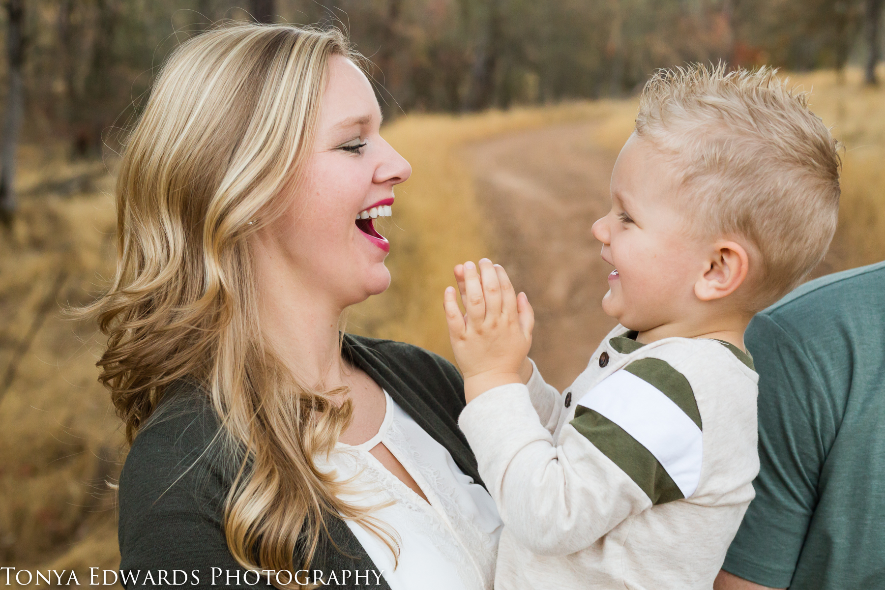 Tonya Edwards | Oroville Family Photographer | Mother and son laughing playing low stress family session