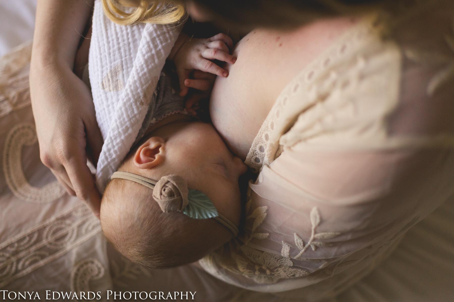 Tonya Edwards Photography | Oroville Family Photographer | breastfeeding mother with newborn baby girl in headband