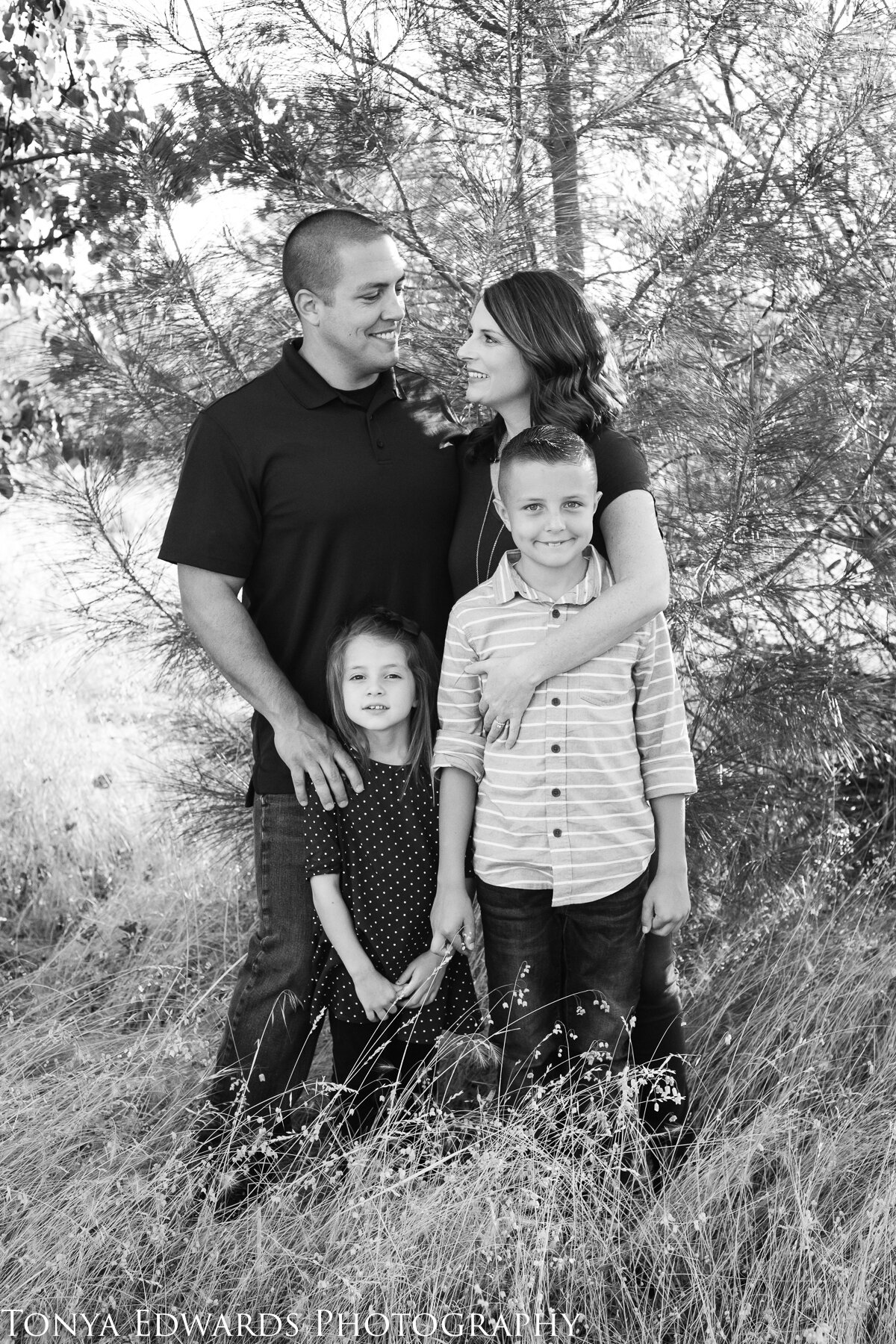 Tonya Edwards | Oroville Family Photographer | Family of four black and white standing pose