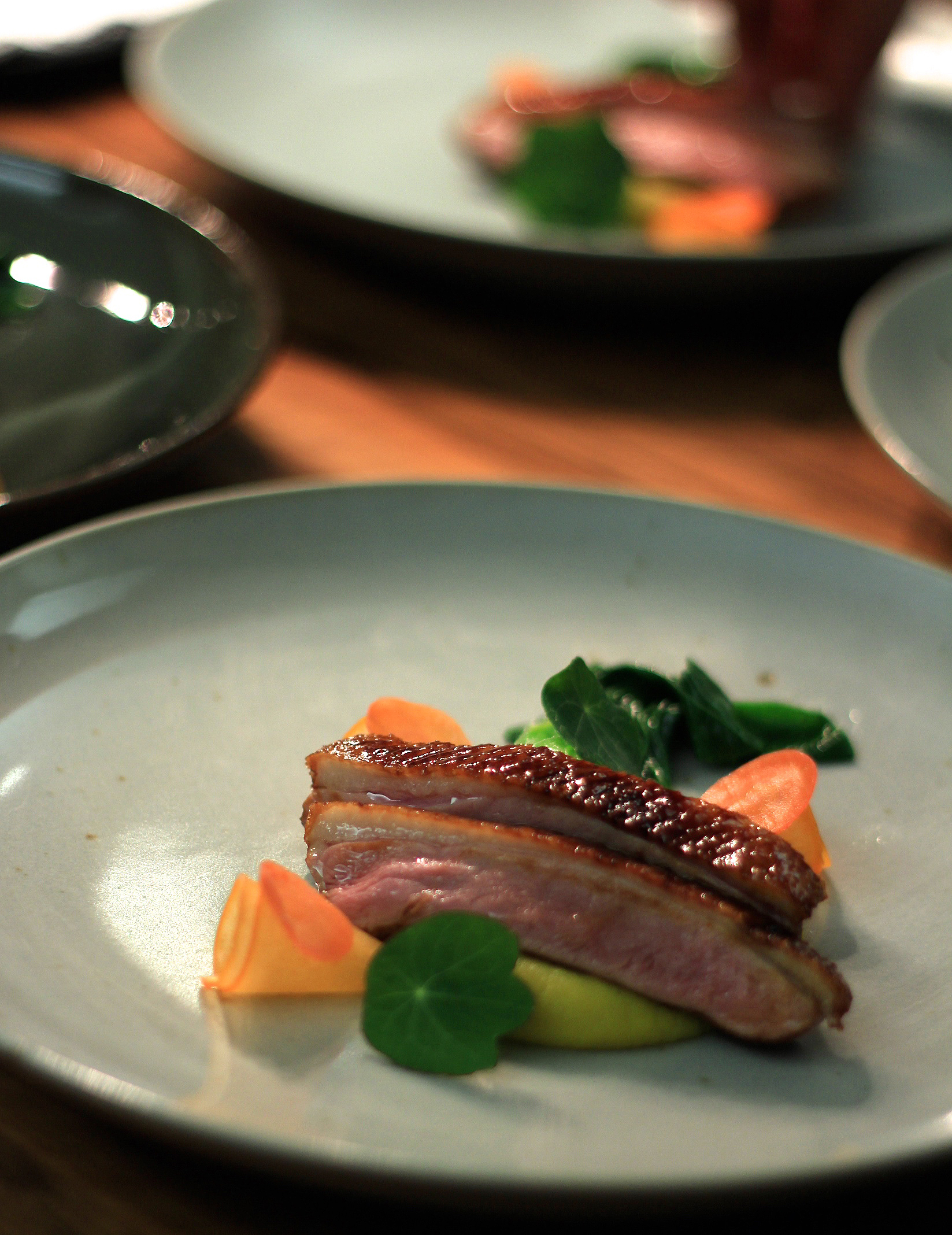 Glazed duck, kumara, bok choy, pickle carrot, persimmon