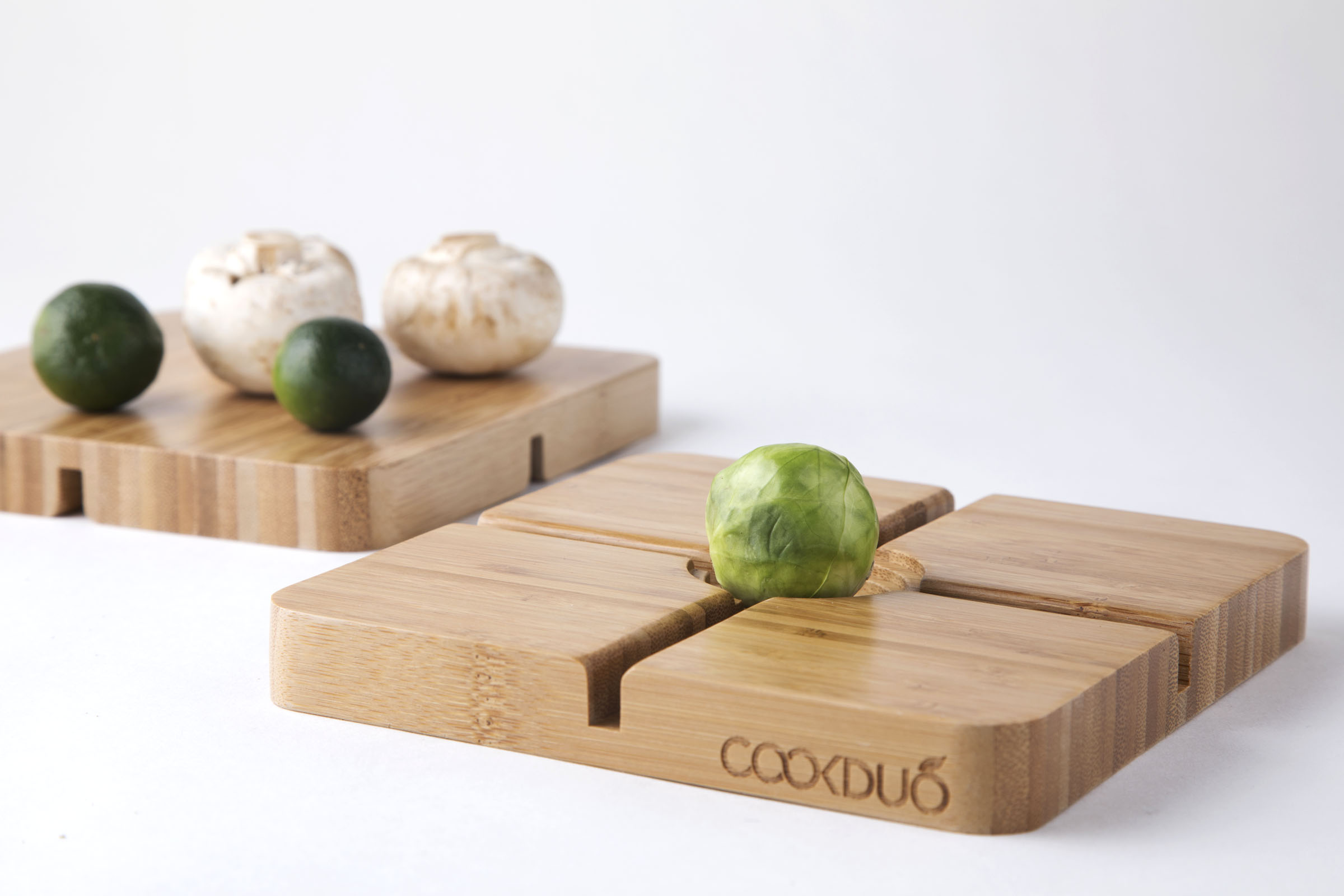 Veggie Gripper - Bamboo cutting board for small round vegetables and fruits (a.k.a. B.Sprout) designed by Madeline ProfioGreat for Brussels sprout, limes, strawberries, mushrooms, cherry tomatoes and much more.