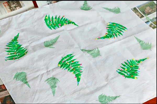 Buggy and Buddy  have this great stencil idea on their blog - just paint on to a bandana or square of fabric (a pillow case cut up is perfect) to make a cool unique Christmas wrapping.