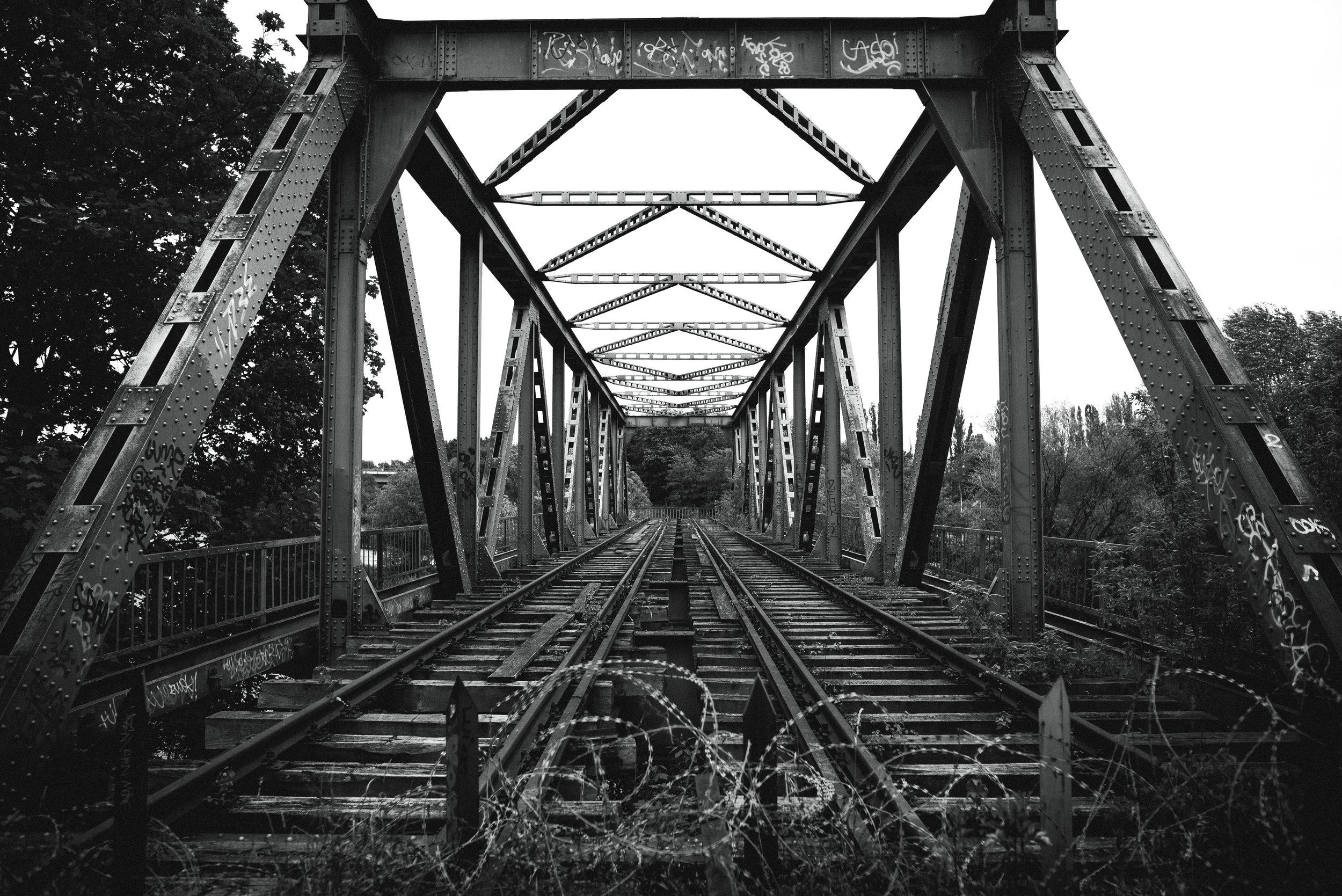 abandoned bridge and train tracks in siemensstadt.