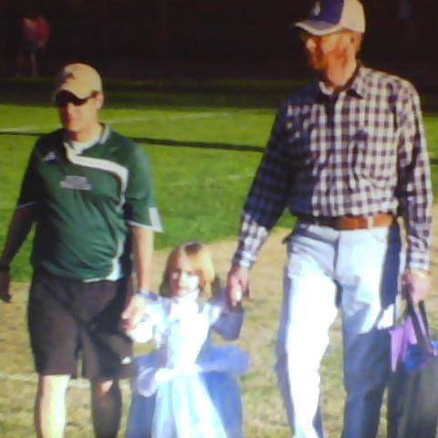 One of my all-time favorite pictures: Dad, my older daughter, and me, on our way to a soccer game.