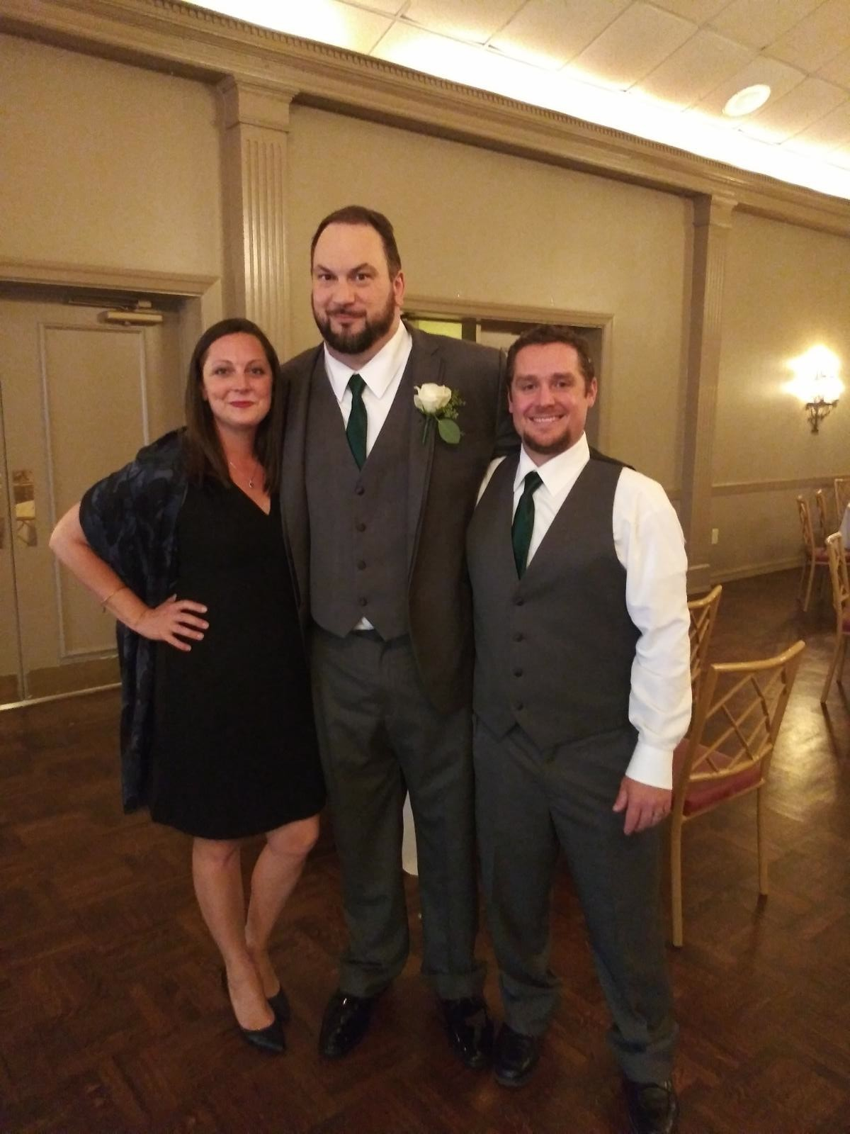 My sister and I with the groom at the reception!