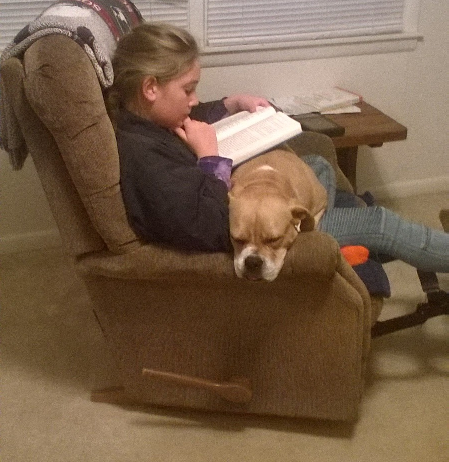 A kid, a book, a pup, and a recliner. This is a serious high-point of life in my world!