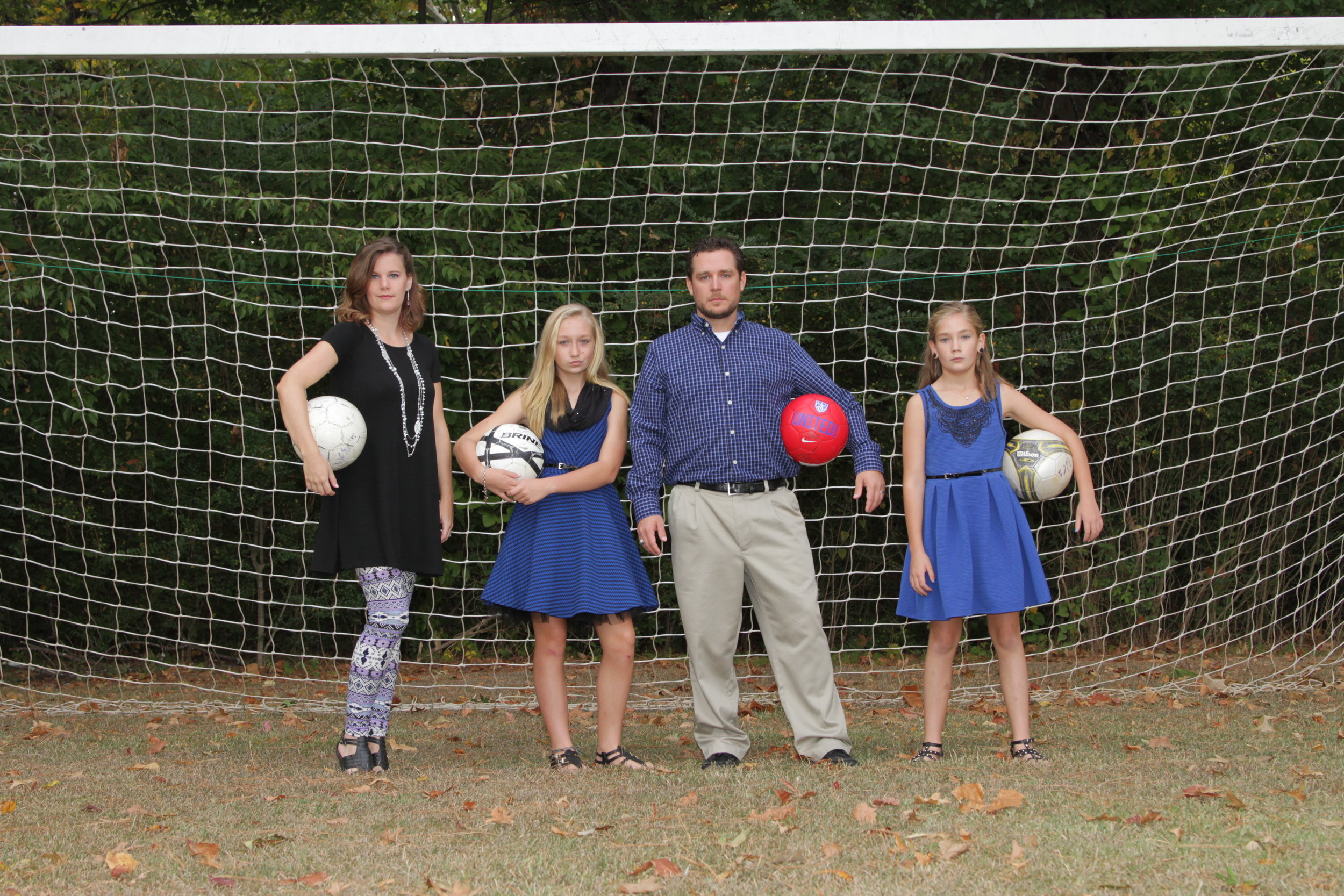 One of my favorite family pictures: mean-mugging with the soccer balls in front of a goal!