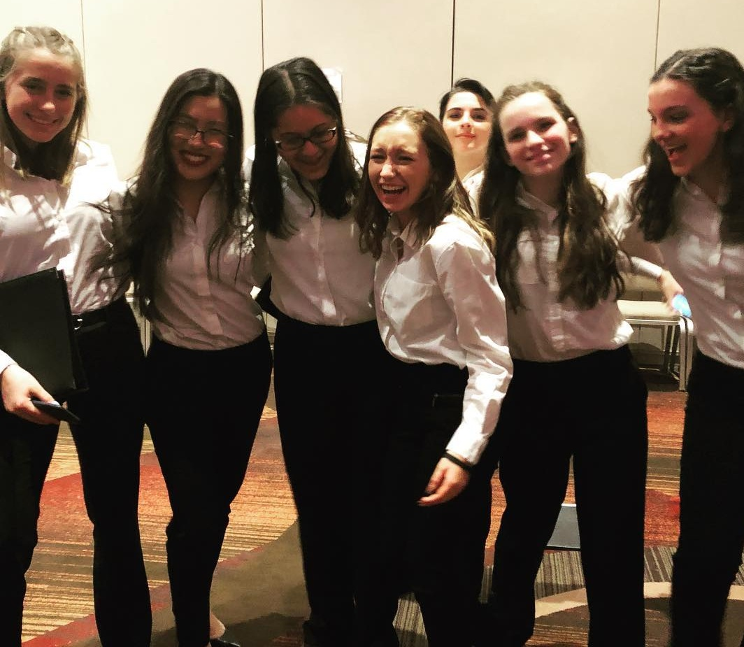Carly and her friends celebrating after their performance. LOVE how well she makes friends and how much fun they had together.
