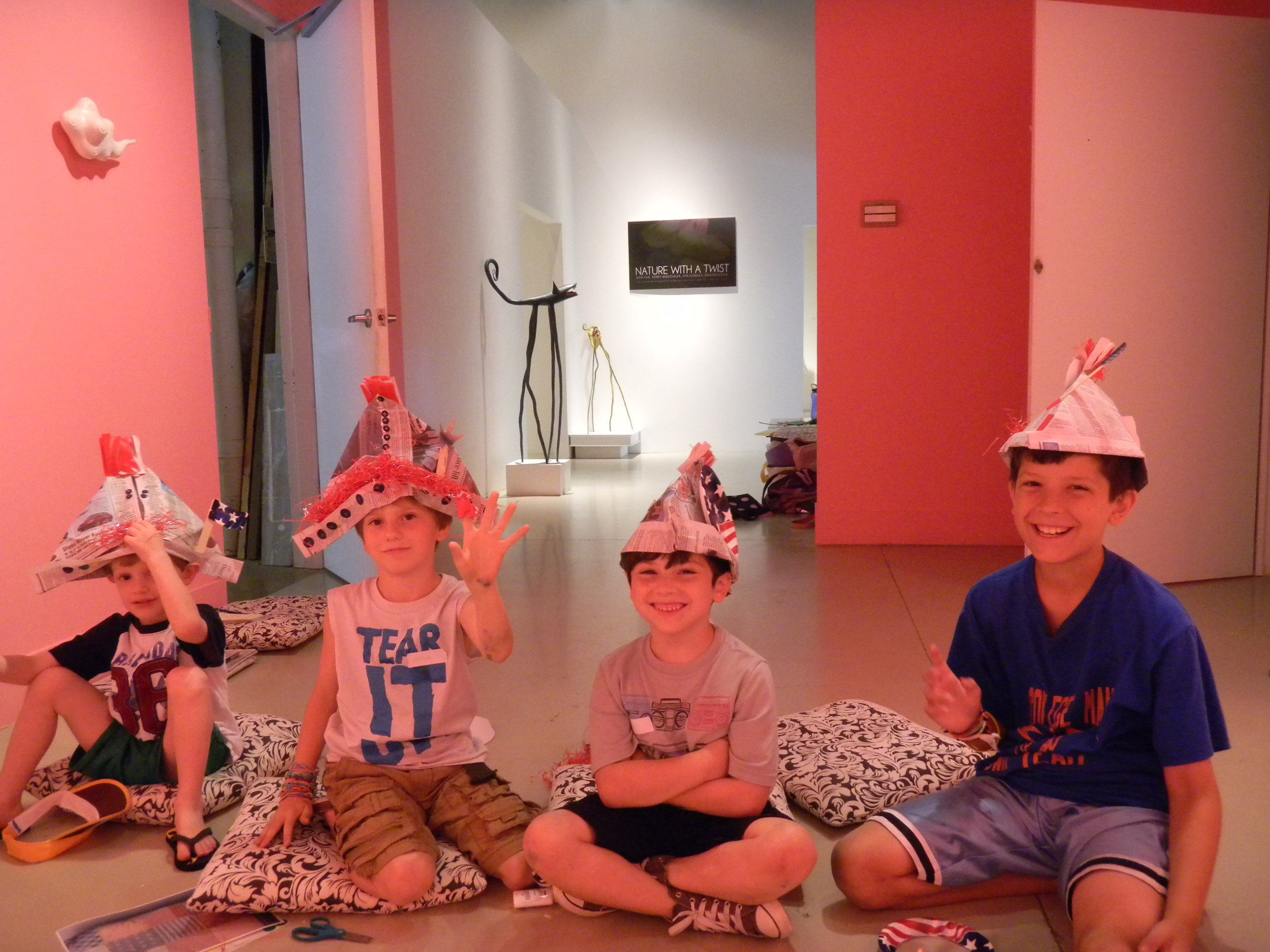 Kids with hand made personality hats