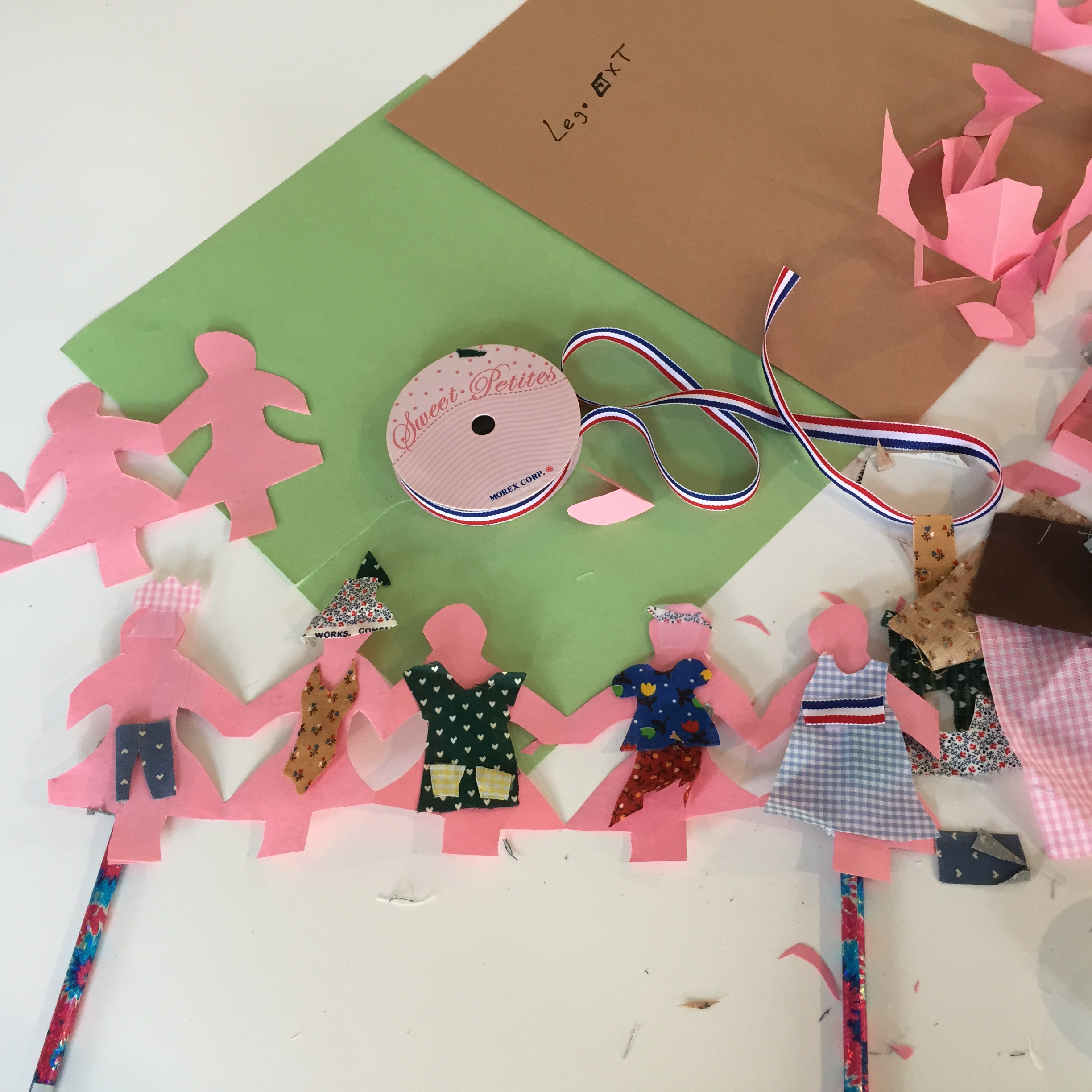 String of paper dolls made from So Made kit