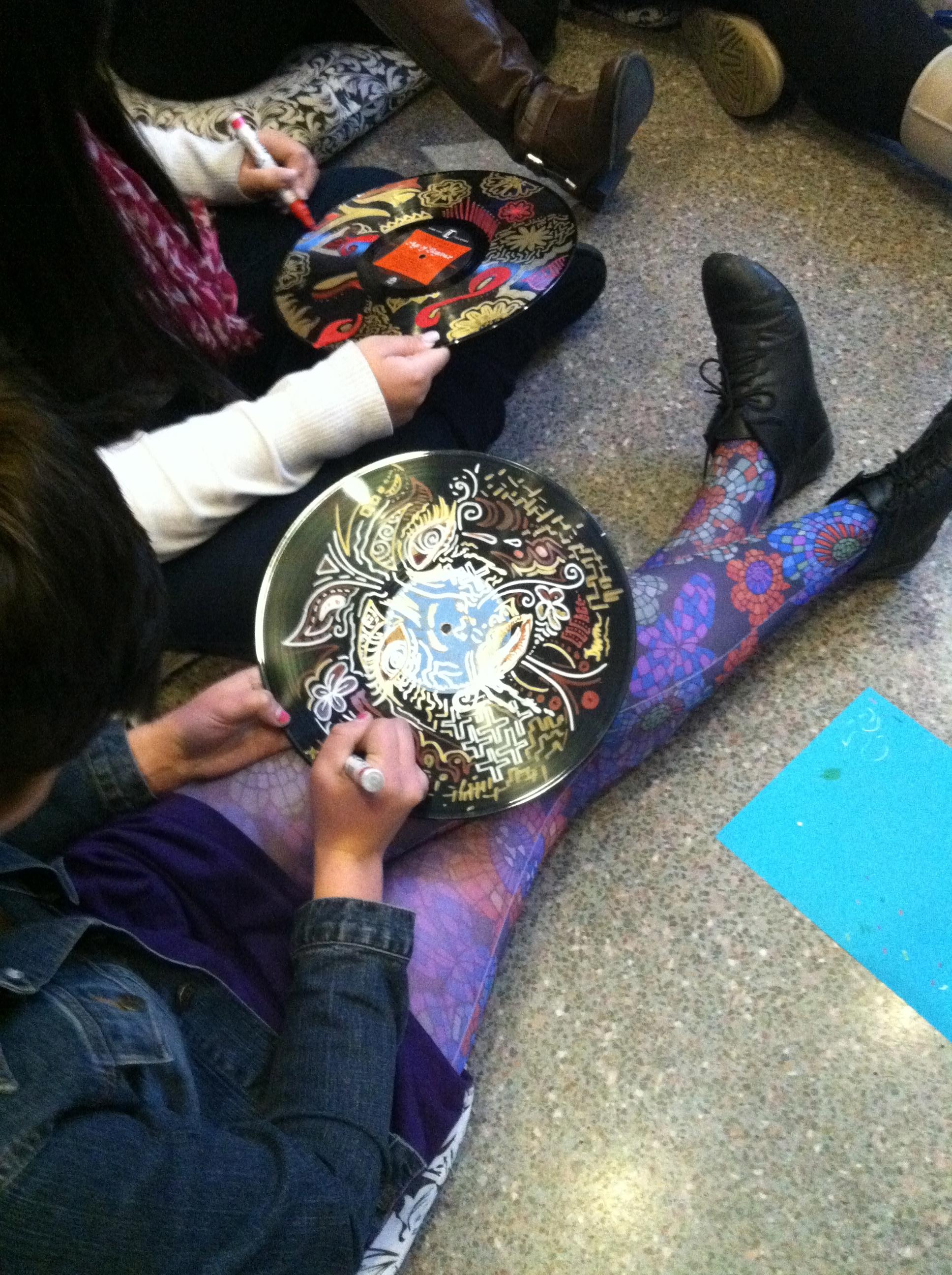 Teens designing patterns on vinyl